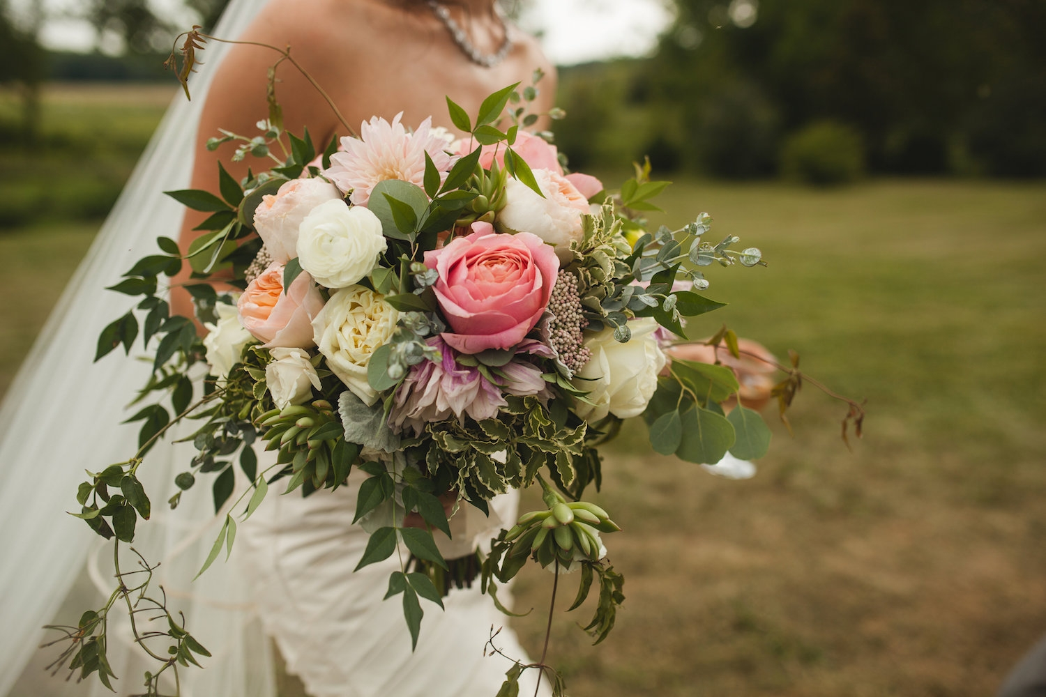 Jennifer loves the Ranunculus, Zinnia, Garden Roses and Rice Flower in the bouquet. Photography by Carly Romeo + Co.