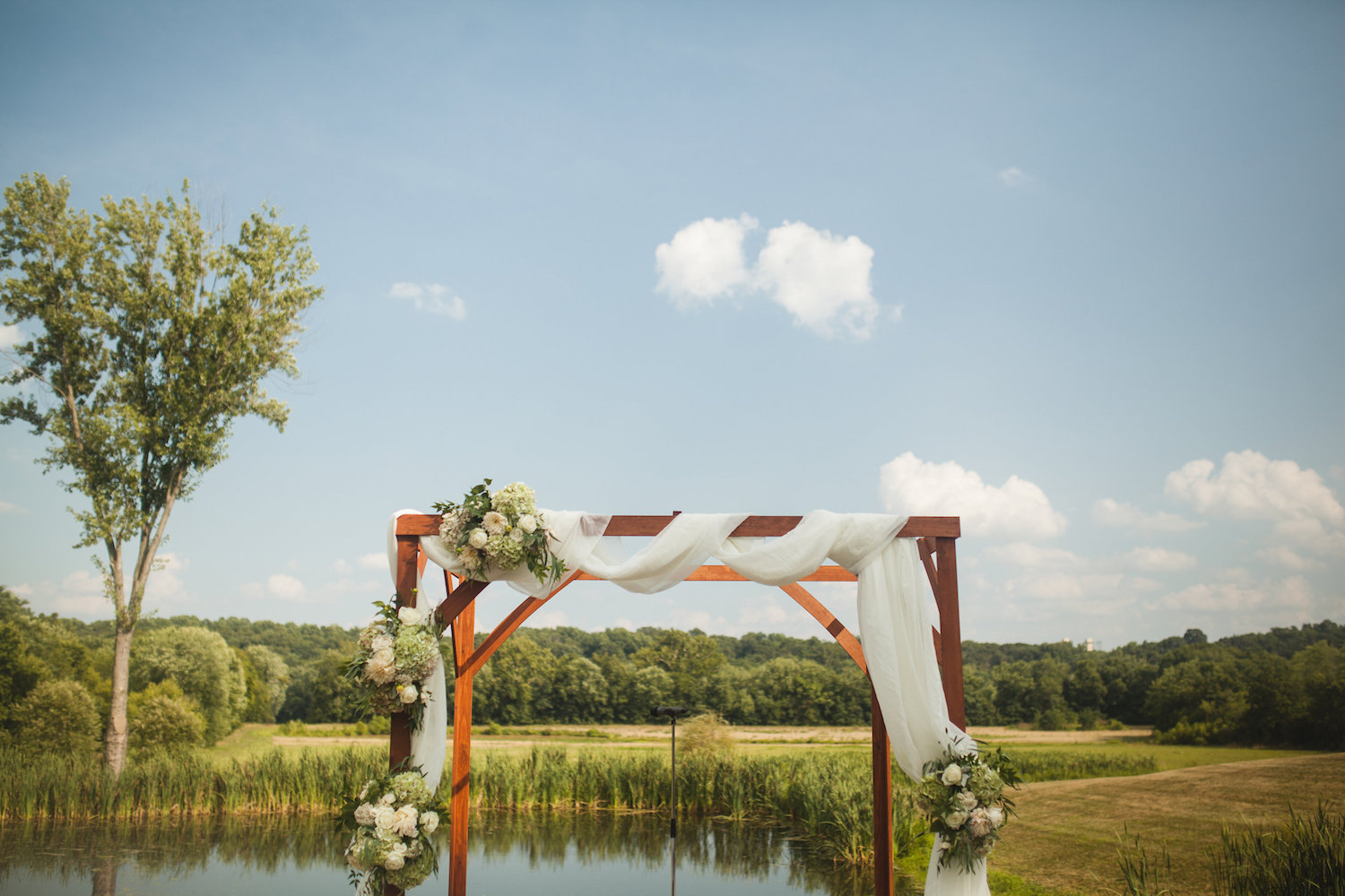 A friend of Danielle's father built the Chuppah that featured cascading flower bundles. Photography by Carly Romeo + Co.