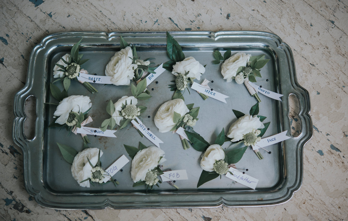 Our designer Katie added an elegant touch to her organization by labelling and displaying the boutonnieres on an antique silver tray. No worries-no mistakes. Photography by The Purple Fern.