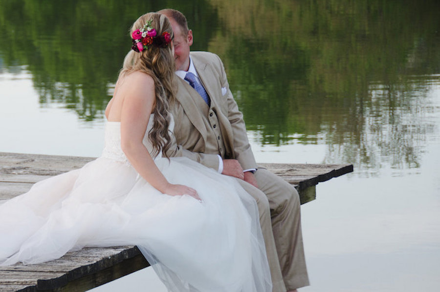 Newlywed Megan Ryan loved the fresh flowers and hair style designed by Styles by Jette.Photography by Sarah E Fortney.