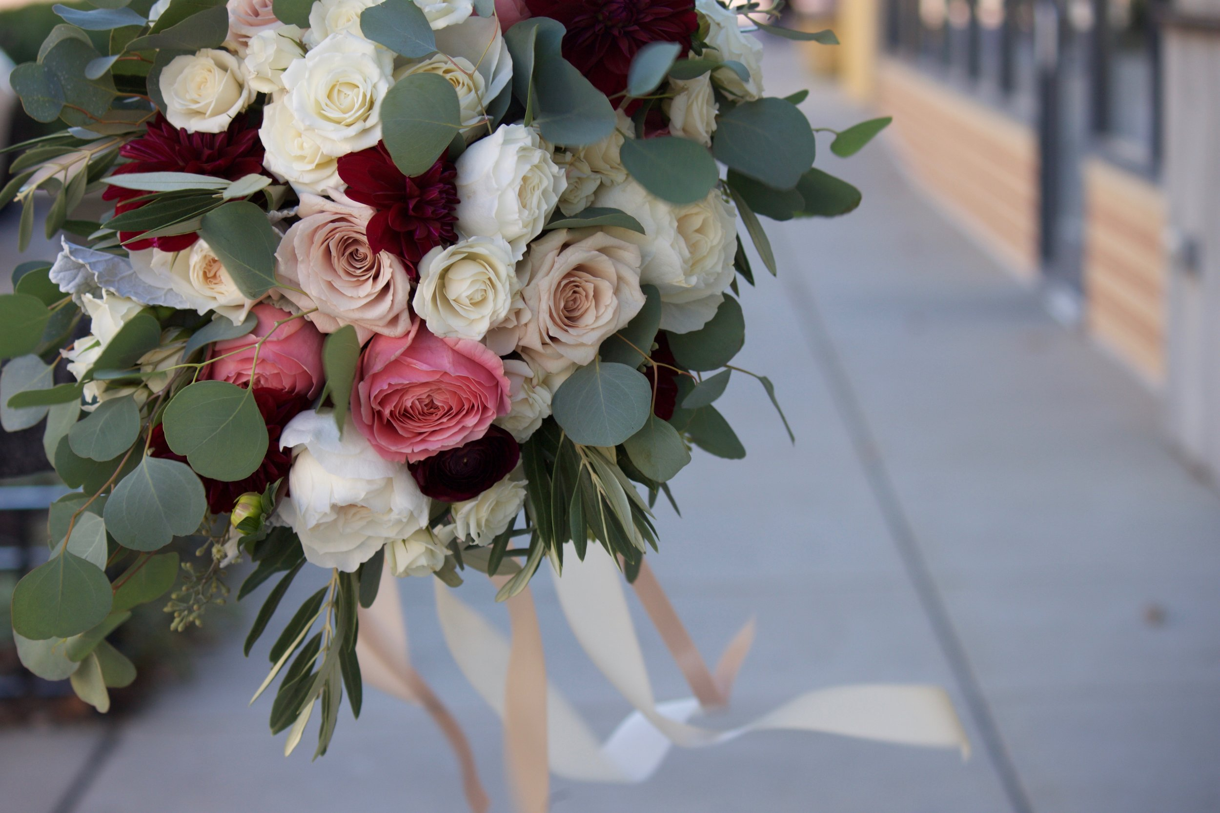 "Greeneries are the common element between floral bouquets and ""greens-only"" accents."