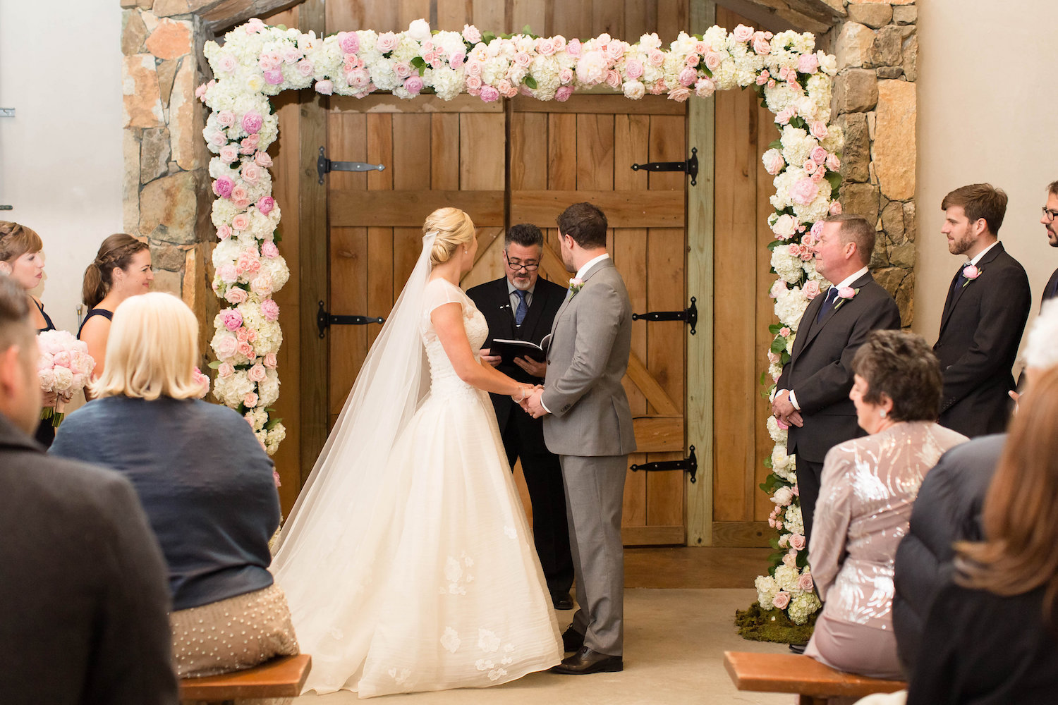 Full floral arch with Peonies, Hydrangea and Garden Roses at Stone Tower Winery. Photography by Candice Adelle.