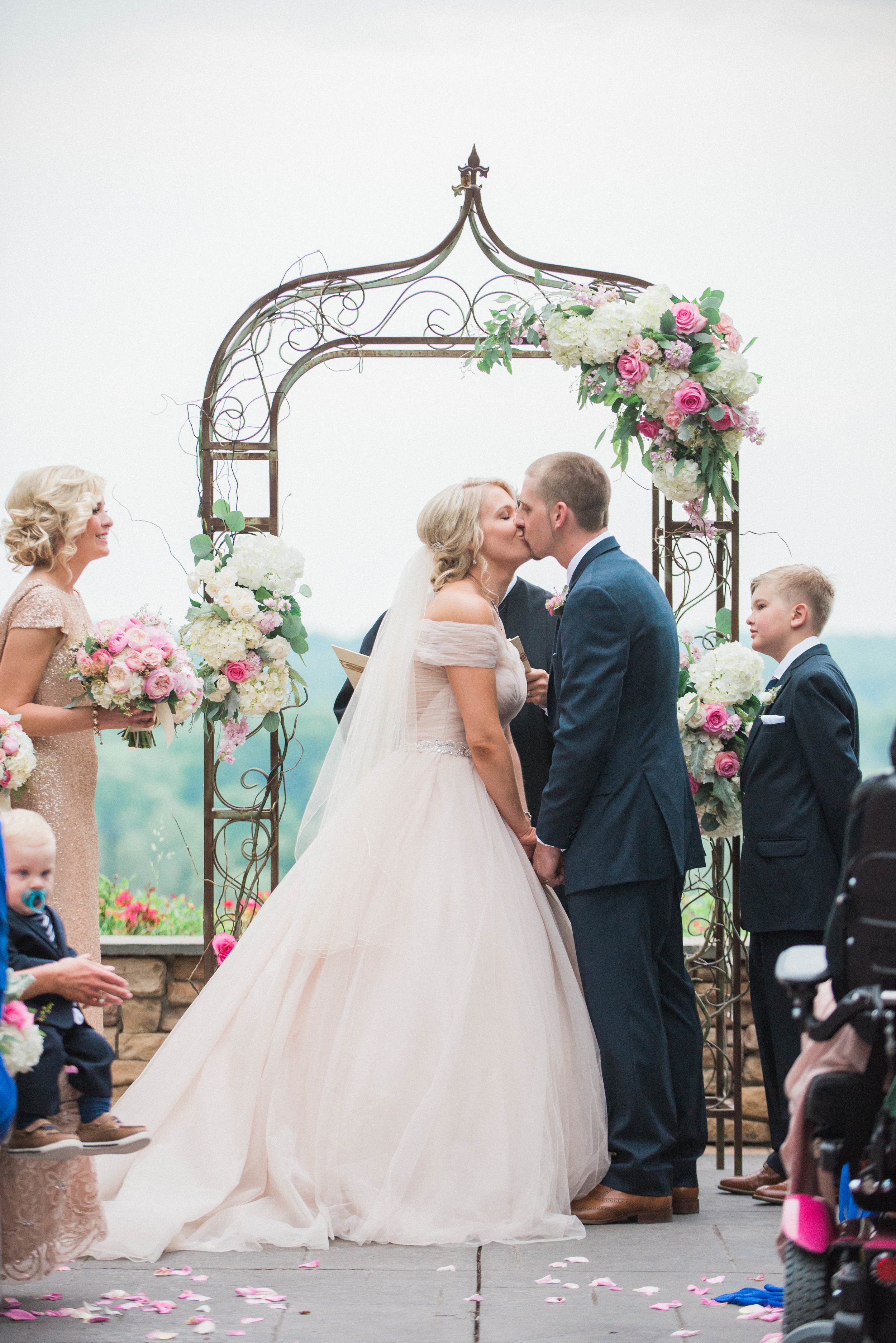 Rental Arch with florals and branches, photography by Megan Schmitz Photography.
