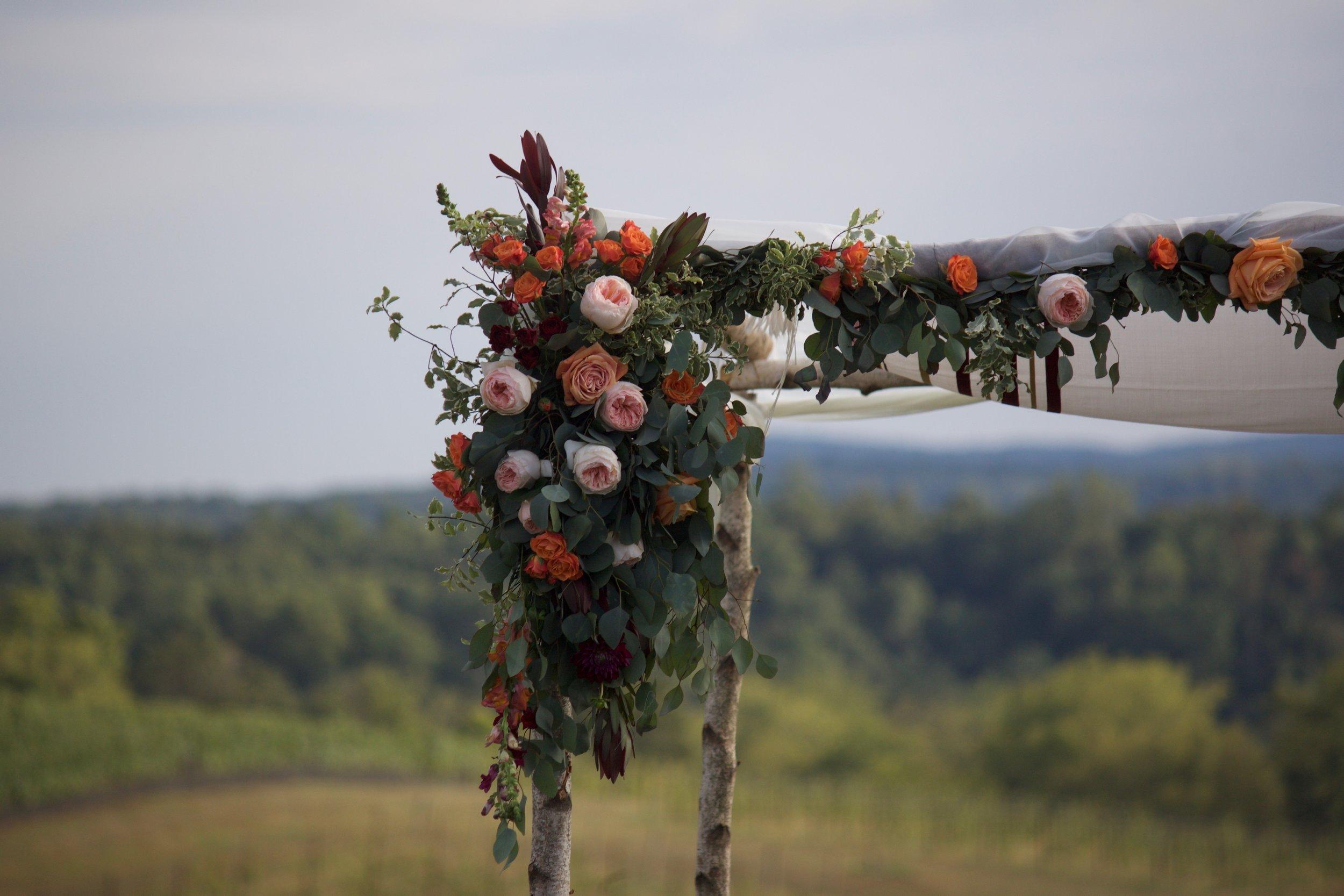 Partial florals and drape by J. Morris Flowers.
