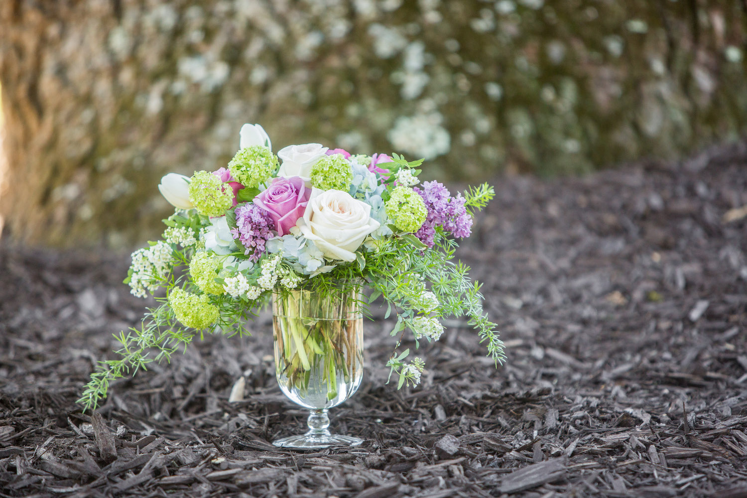"""Collette"" with Viburnum, Lilac, Spirea, Tulips and Roses"