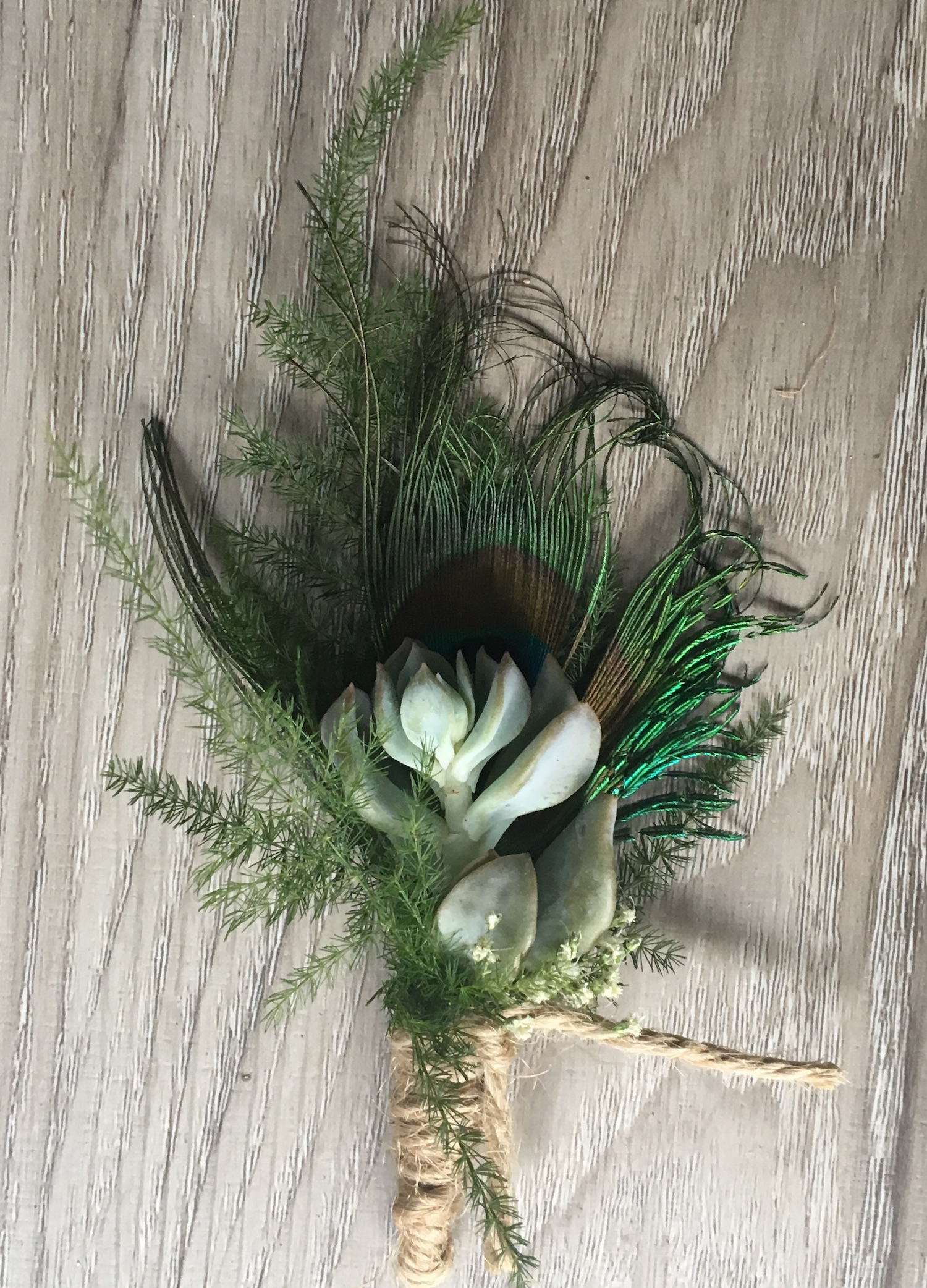 The Boutonniere with Peacock Feather for a hint of teal.