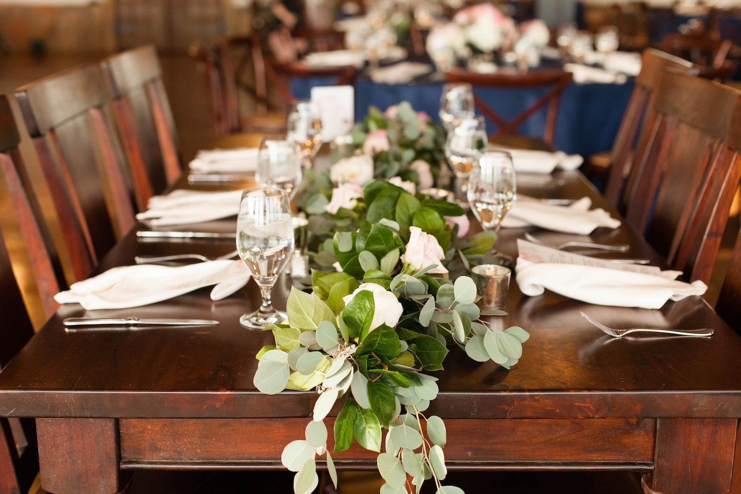 Garland on wooden farmhouse tables at Stone Tower Winery, Leesburg, Virginia. Photography by Candice Adelle.