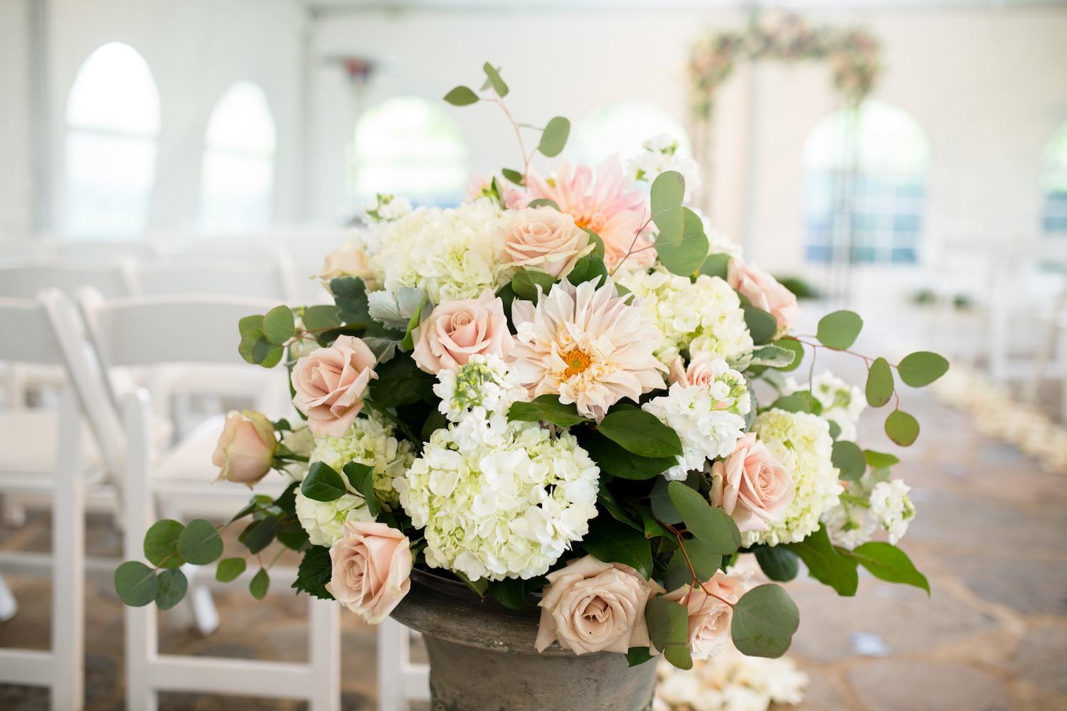 Stunning ceremony urn with Cafe Au Lait Dahlia's at Poplar Springs Inn. Photo by Lovesome Photography.