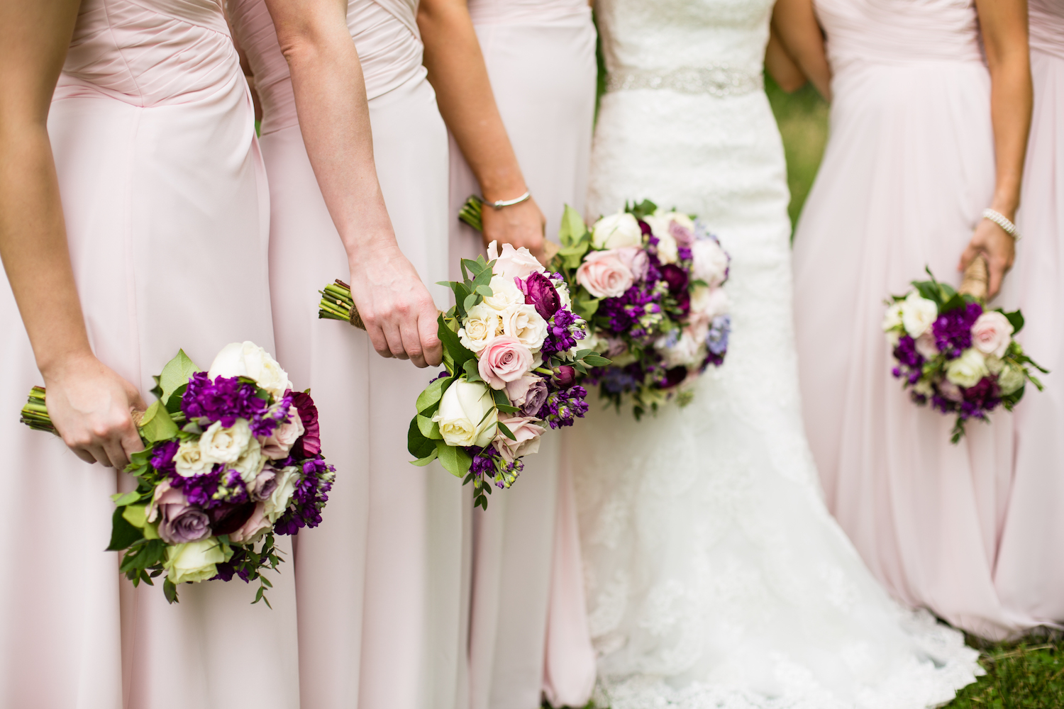 Blush pink dresses pop in contrast with deeper hued florals. Pamela Lepold Photography.