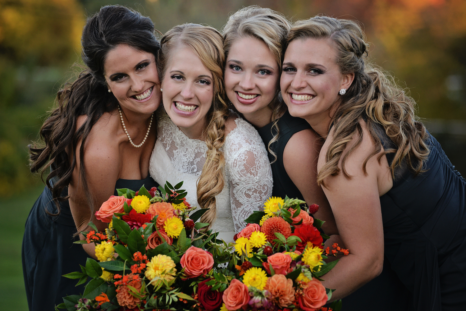 Fall-themed-orange-red-yellow-bridal-bouquets.JPG