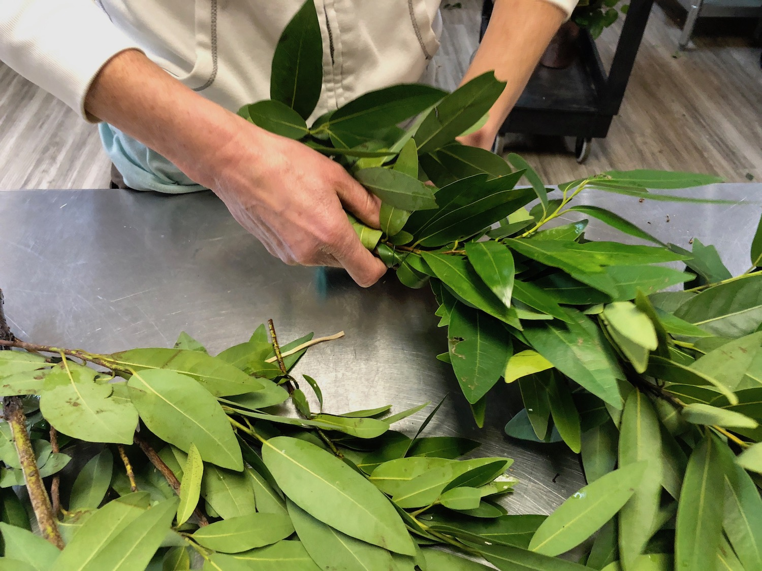 Bay Leaf in a garland being made in our J. Morris Flowers studio.