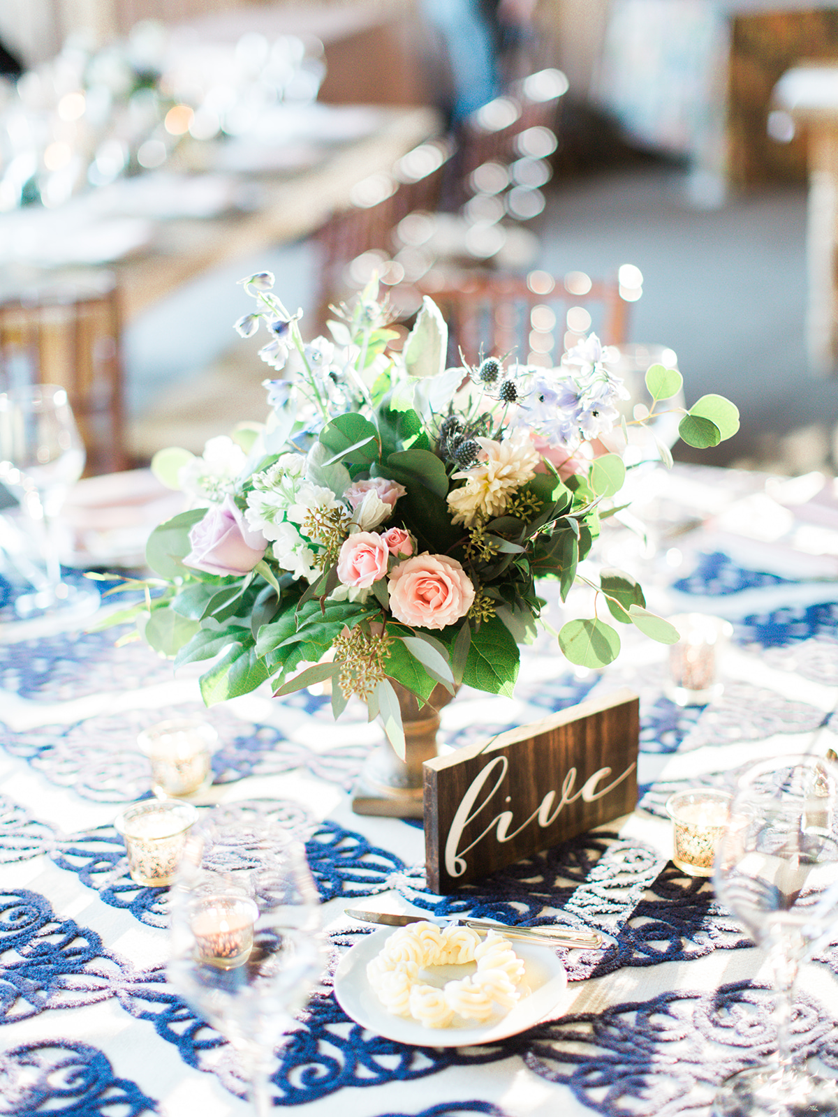 Hannah-Bjorndal-floral-centerpieces-pale-blue-pink-ivory-greenery-thistle.jpg