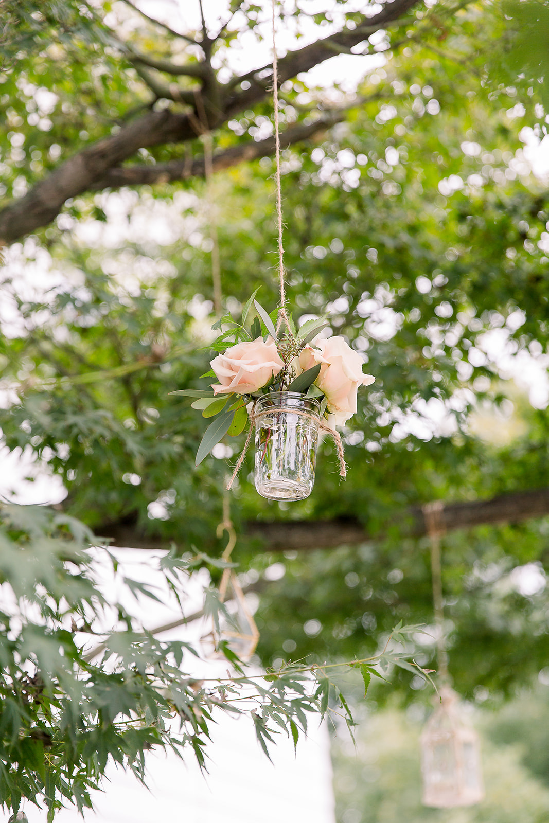 Nicole-Adele-B.mingled-hanging-florals-pink-roses-feather-euc-glass-jars-jmorrisflowers.jpg