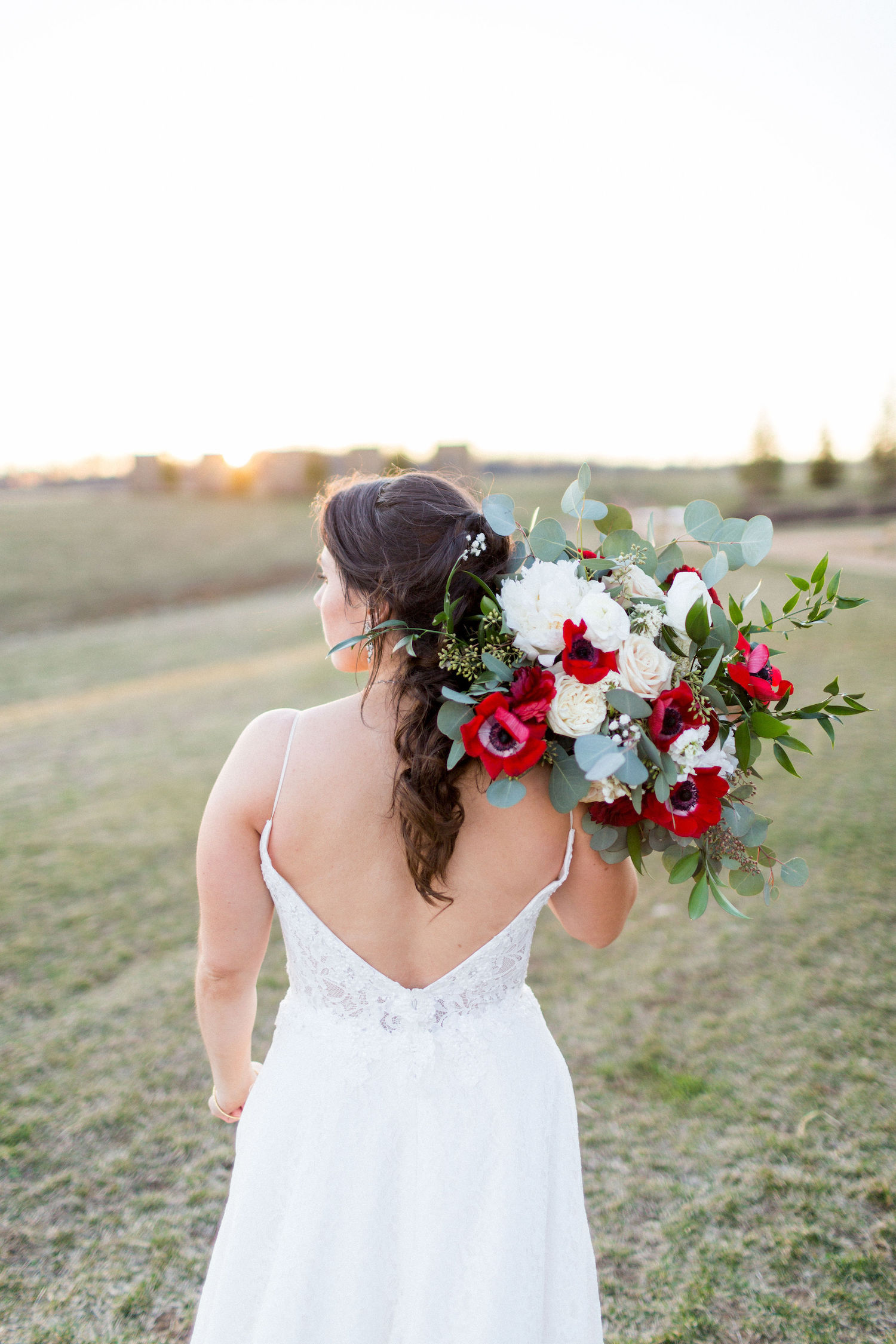 A loose bridal bouquet in white and red at Stone Tower Winery, Kir2Ben photography.