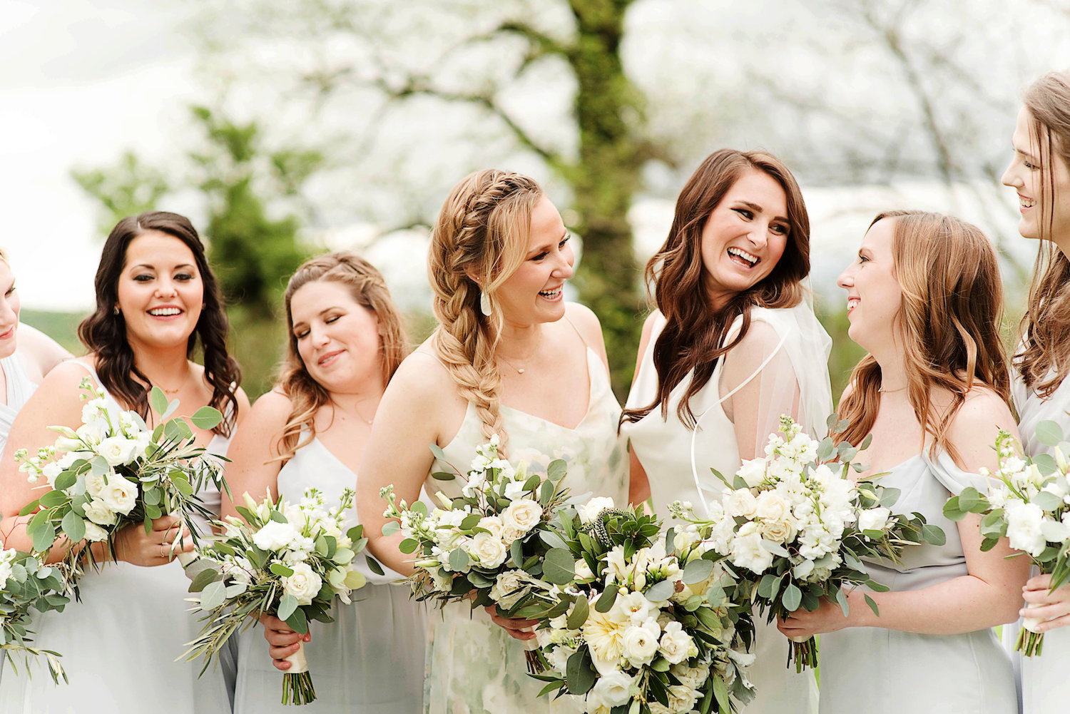 Light grey bridesmaids dresses perfect for this neutral palette. Photography taken at Raspberry Plain Manor in Leesburg, Virginia by the Photography Smiths.