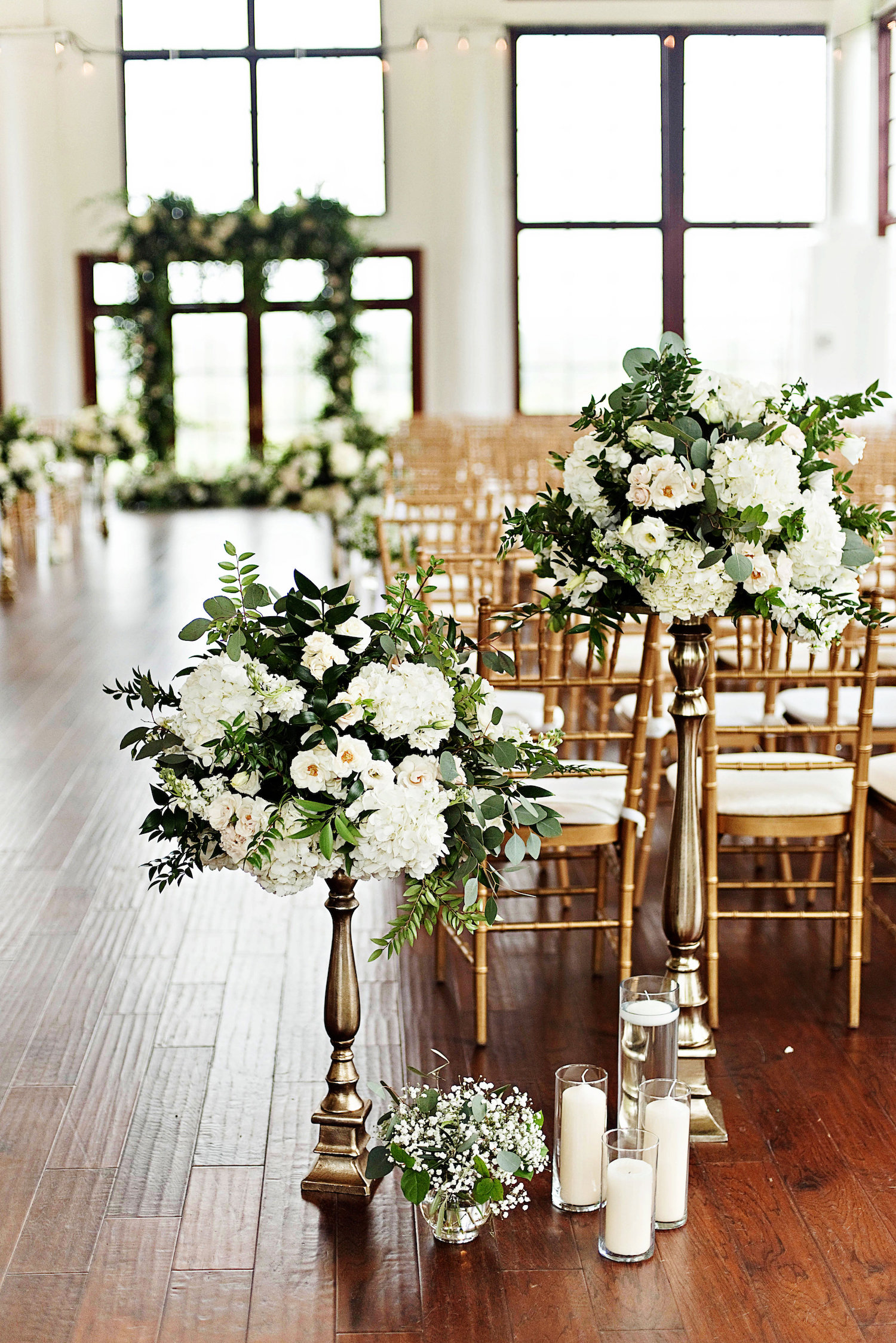 Re-purposed centerpieces helped to add the missing garden element to this inside ceremony planned for the outdoors. Photography by the Photography Smiths at Raspberry Plain Manor.
