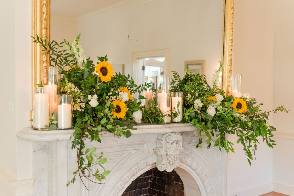 Emily Alyssa Photography took this image of a Sunflower laden mantle at Rust Manor House.