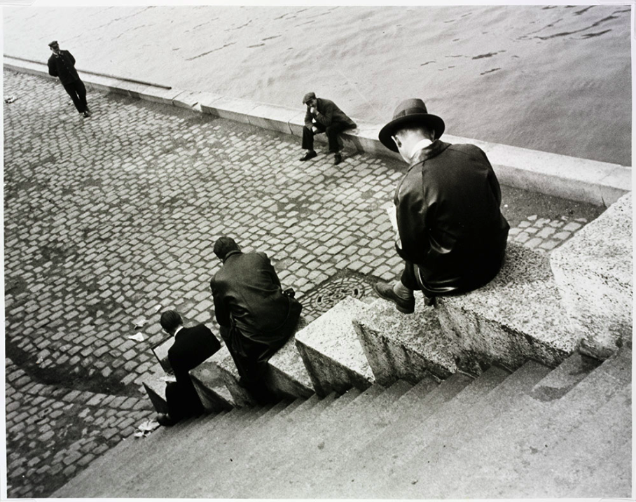 Three men on steps by the Seine , 1931.