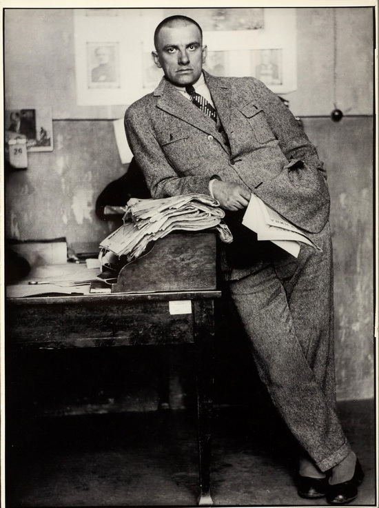 The poet Vladimir Mayakovsky in the editorial office in Moscow , 1927.
