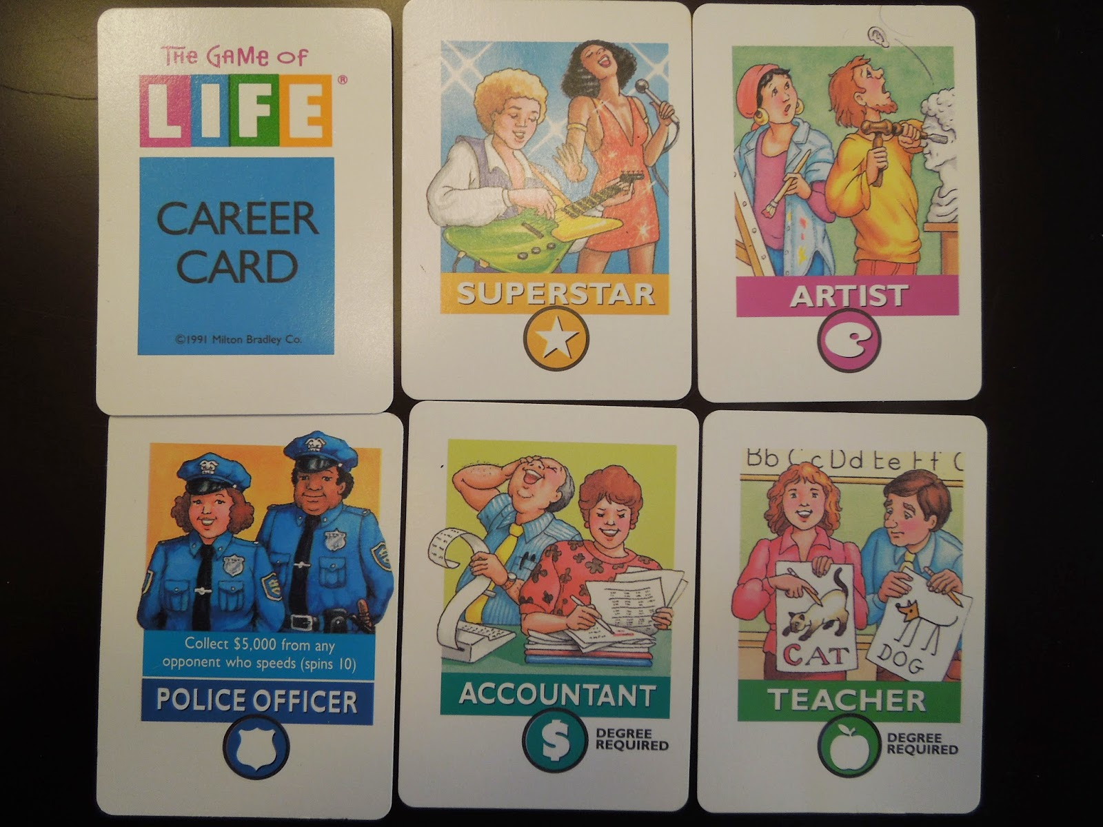 I mean, look at the glee on the accountant's face as he cooks the books in the Game of Life.