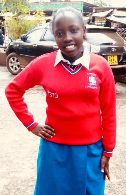 Grace Wangui - Grace attends Kamahuha Girls Secondary School and is in Form 2.