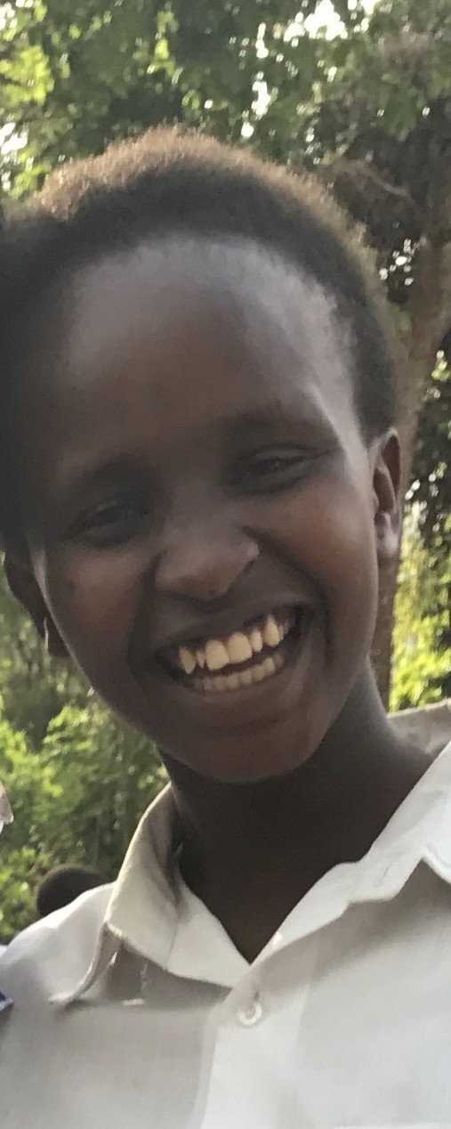 Carol Mwende - Carol attends Kamahuha Girls Secondary School and is in Form 4.