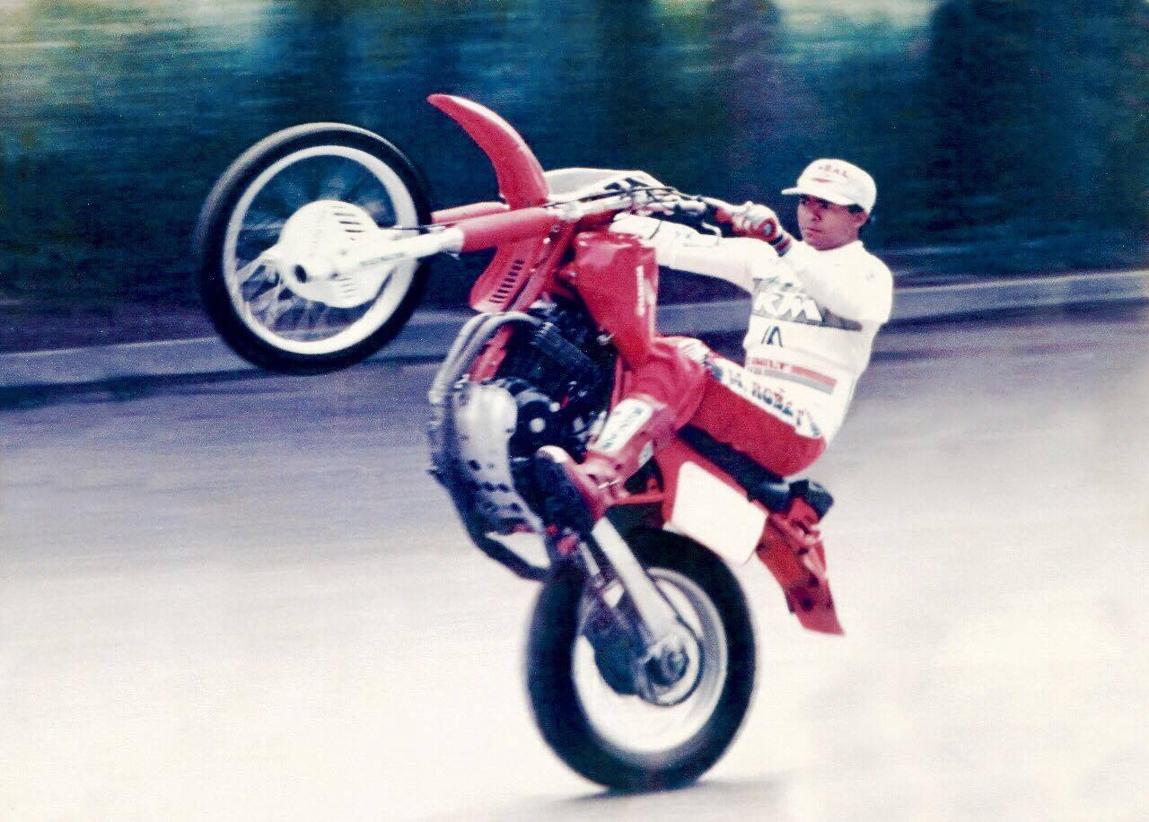 My dad, Moisés, doing a wheelie circa 1990. *Always wear a helmet when riding a motorcycle. Especially when doing stunts.*