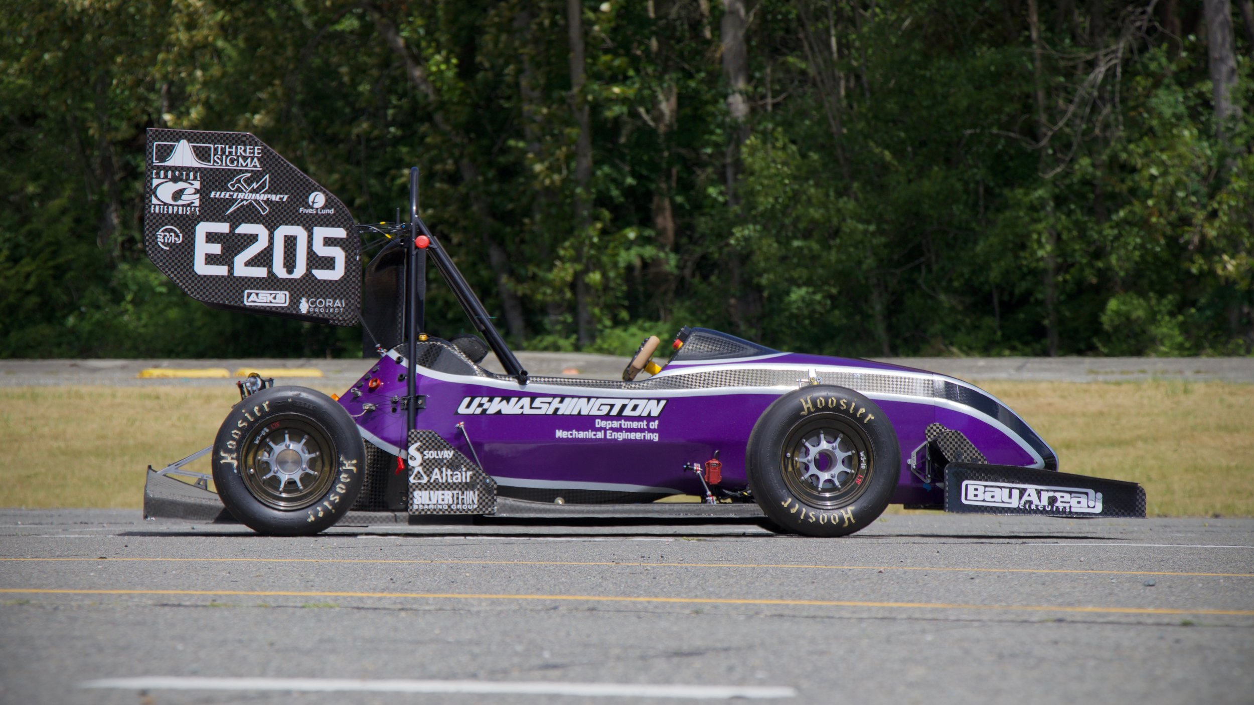 UW Formula Motorsports 2018 Team 29 eCar, with CORAI logo on lower right hand corner of wing.