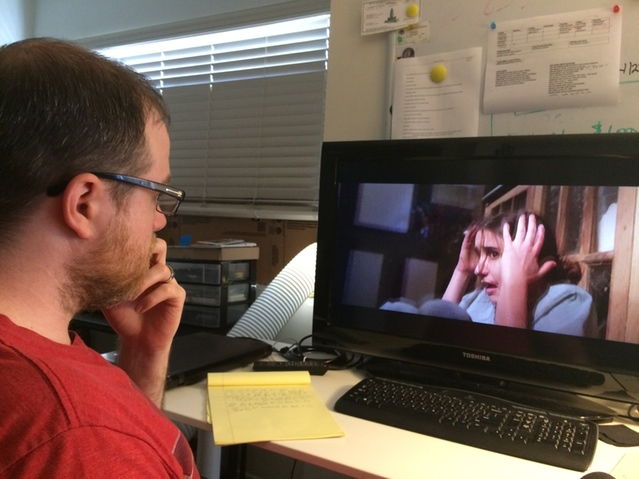 Director Jess Kreusler watches a rough cut of THE RIFT.