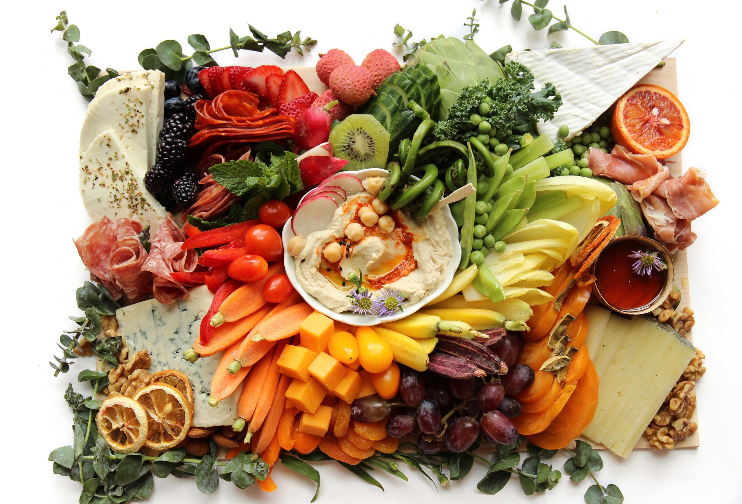 edible art - We are so excited to announce that we are now offering Grazing Boards in NYC. One of our favorite activities in the city is to visit the Farmers' Market, alive with tons of colors, scents, and tastes. It makes this concrete jungle feel a bit more beautiful and us a bit more connected with the Earth. We have loved creating boutique boards from our Farmers' Market visits for our friends and family for years and we're so excited to now offer them to our NYC community. Just the sight of these boards makes you slow down, engage in conversation and bring a sense of togetherness, all while nourishing our bodies.