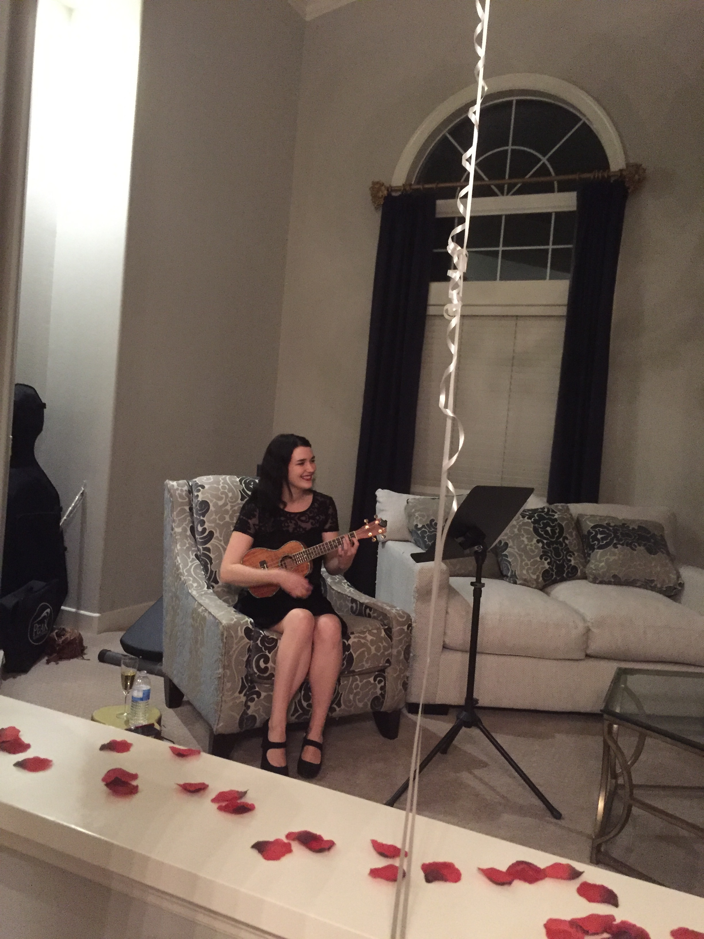 i had the honor of singing/ playing for a private proposal dinner. with balloons and rose petals everywhere, a private chef, and live music, how could she say no?!?