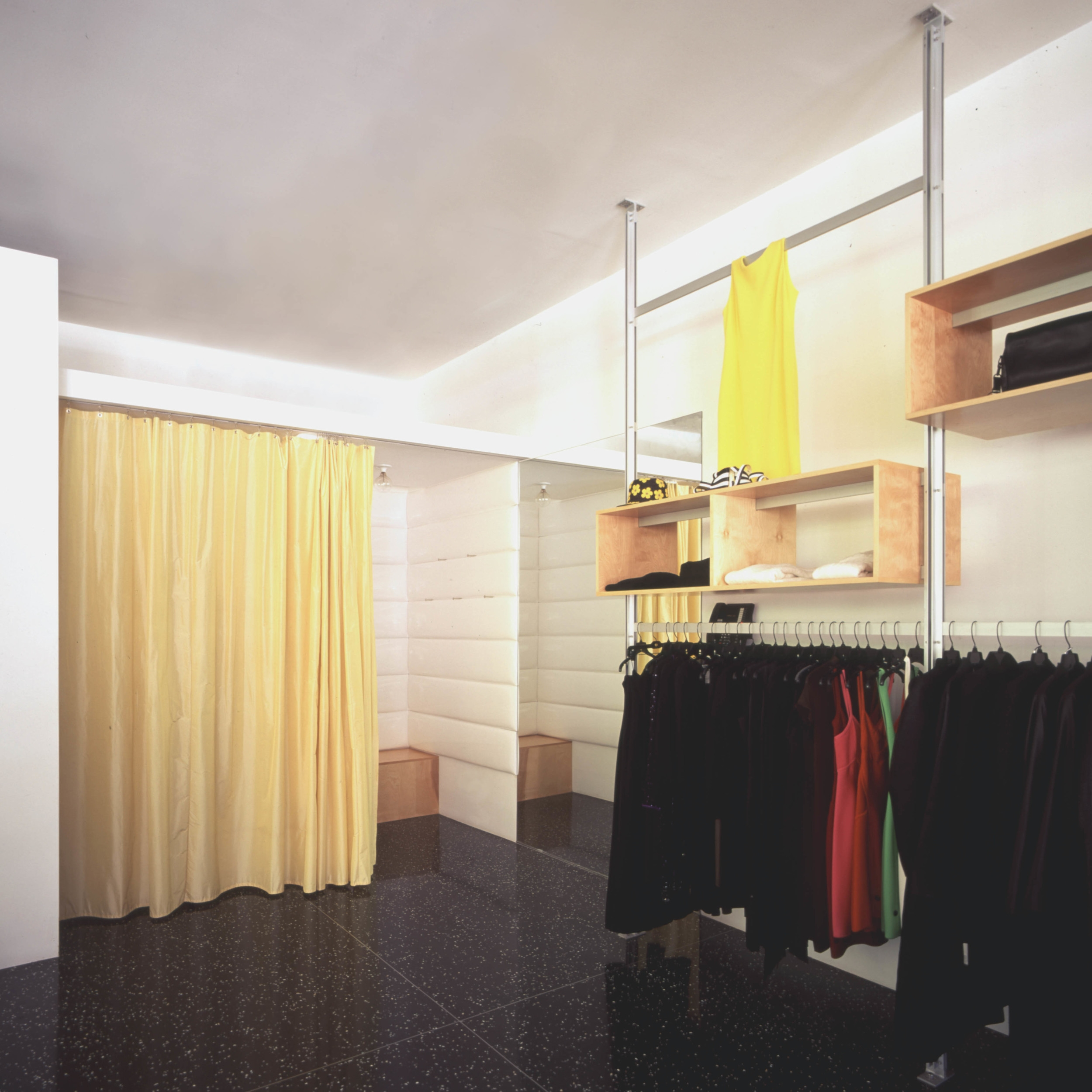 Maxfield Dressing Rooms with Black Terazzo Floors, Padded Wall Paneling and Silk Curtains