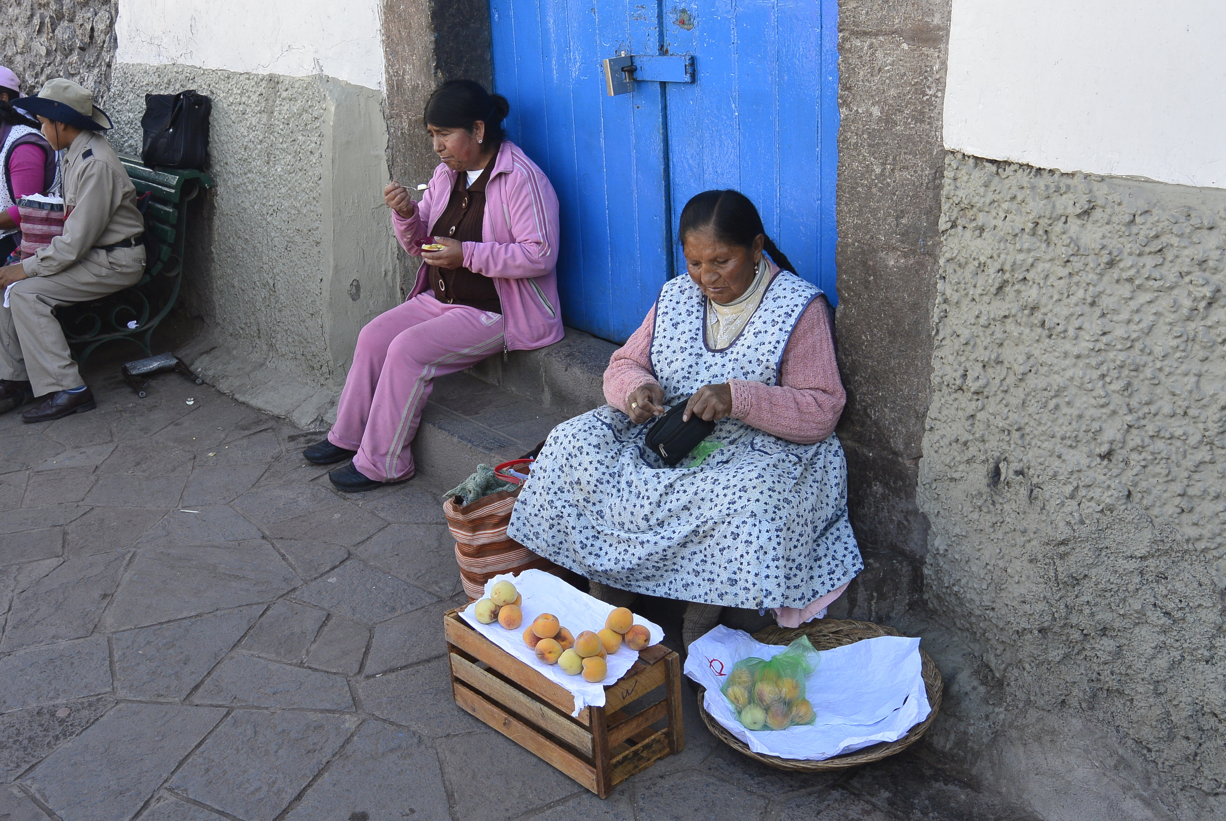 Peruvian Women selling fruit in Cusco Peru