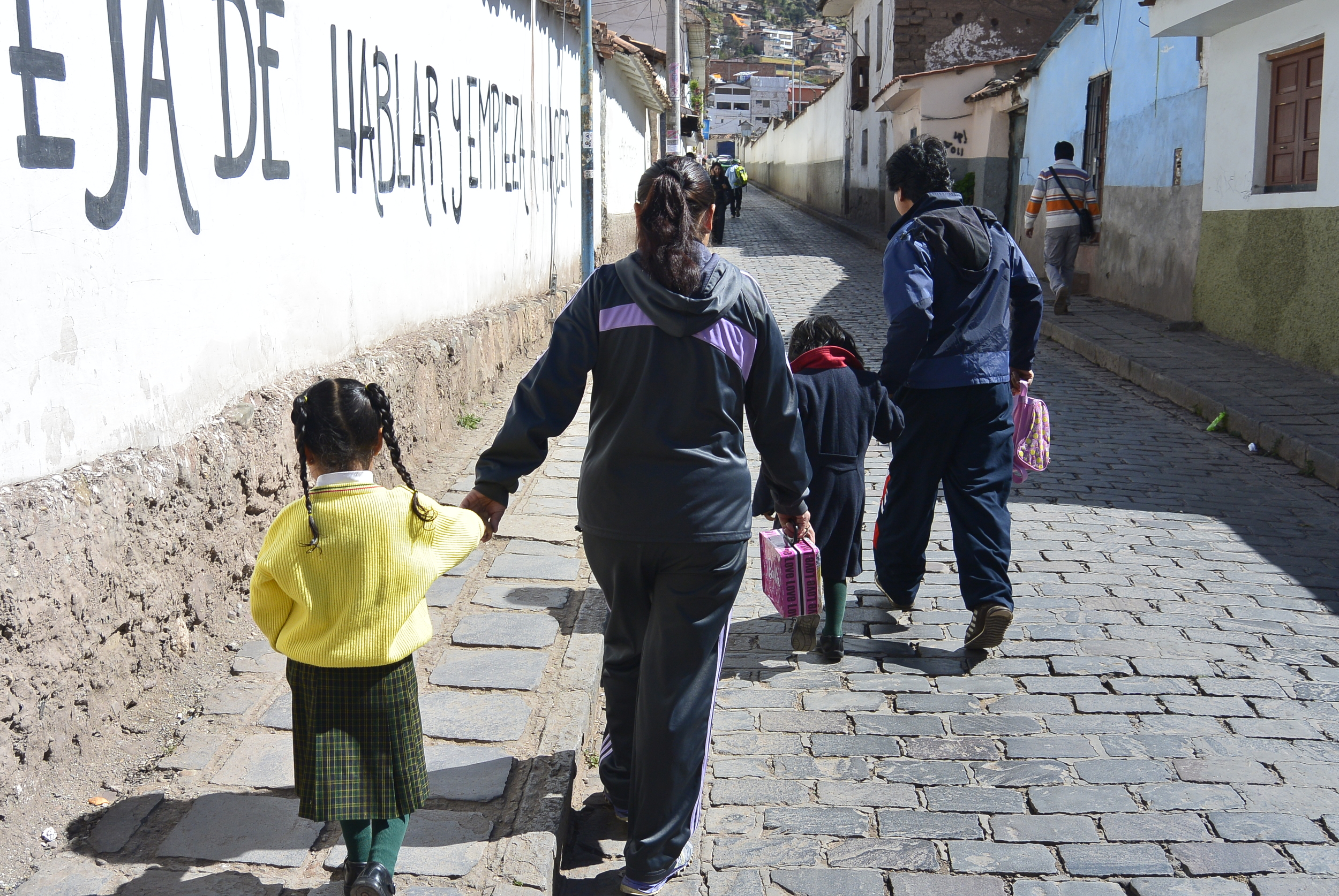Cusco Peru Peruvian Family walk down street