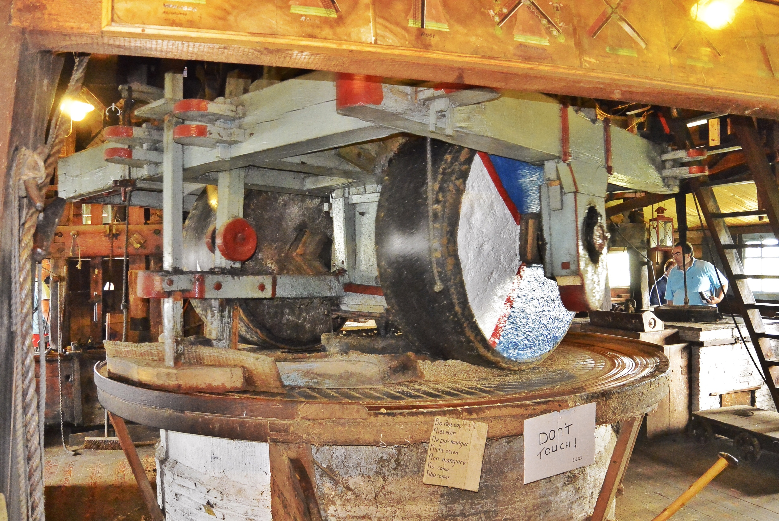 De Zoeker Windmill Grinding Nuts into oil in Zaanse Schans