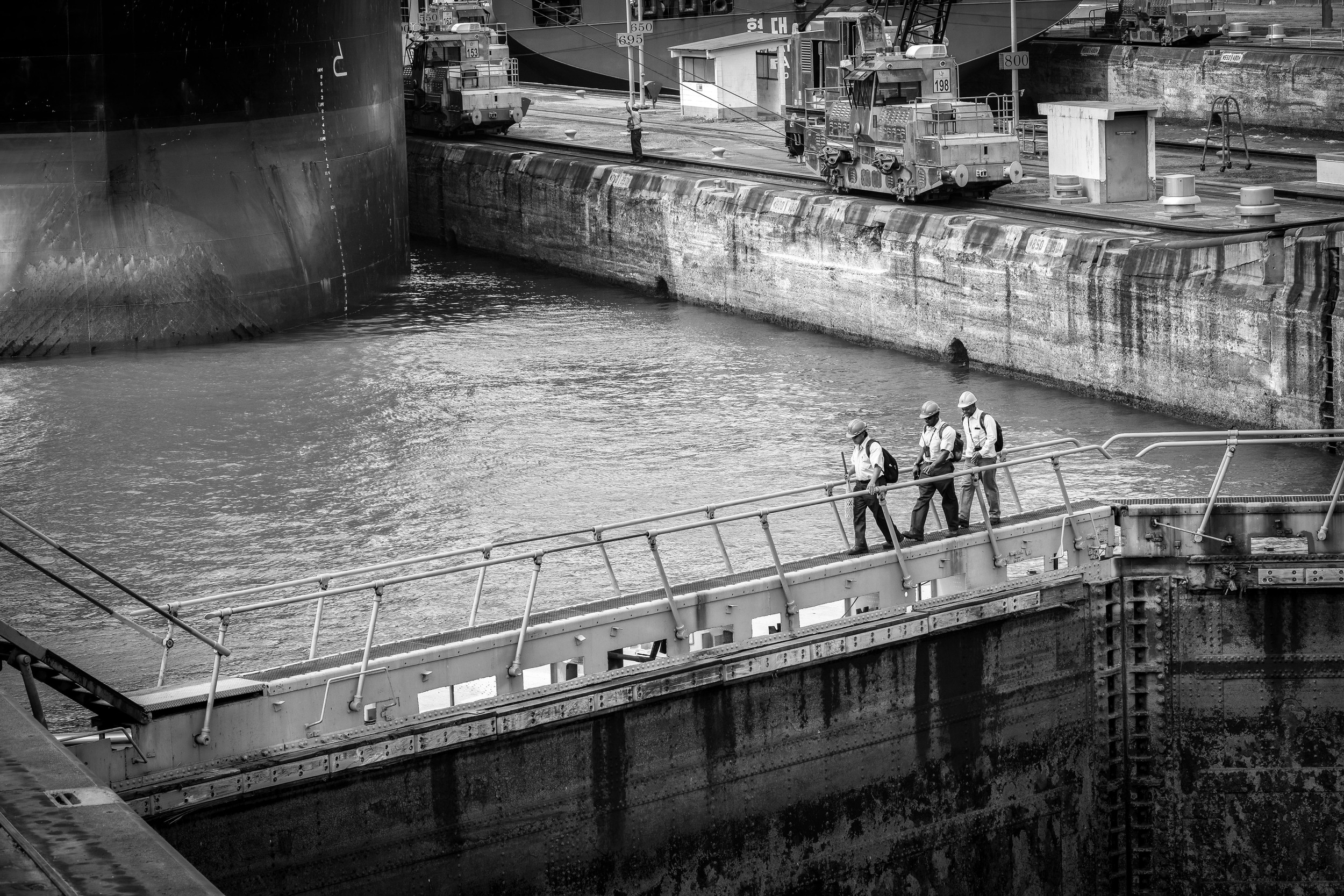 Panama Canal workers crossing a lock
