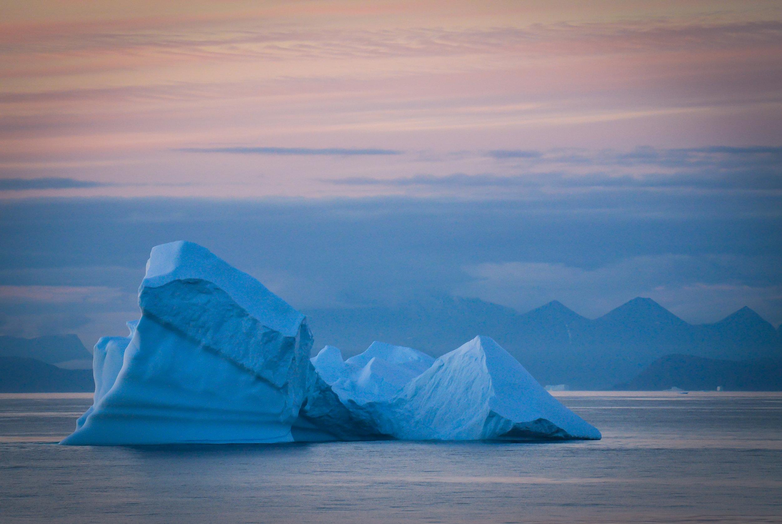 Iceberg at sunset off the coast of Greenland