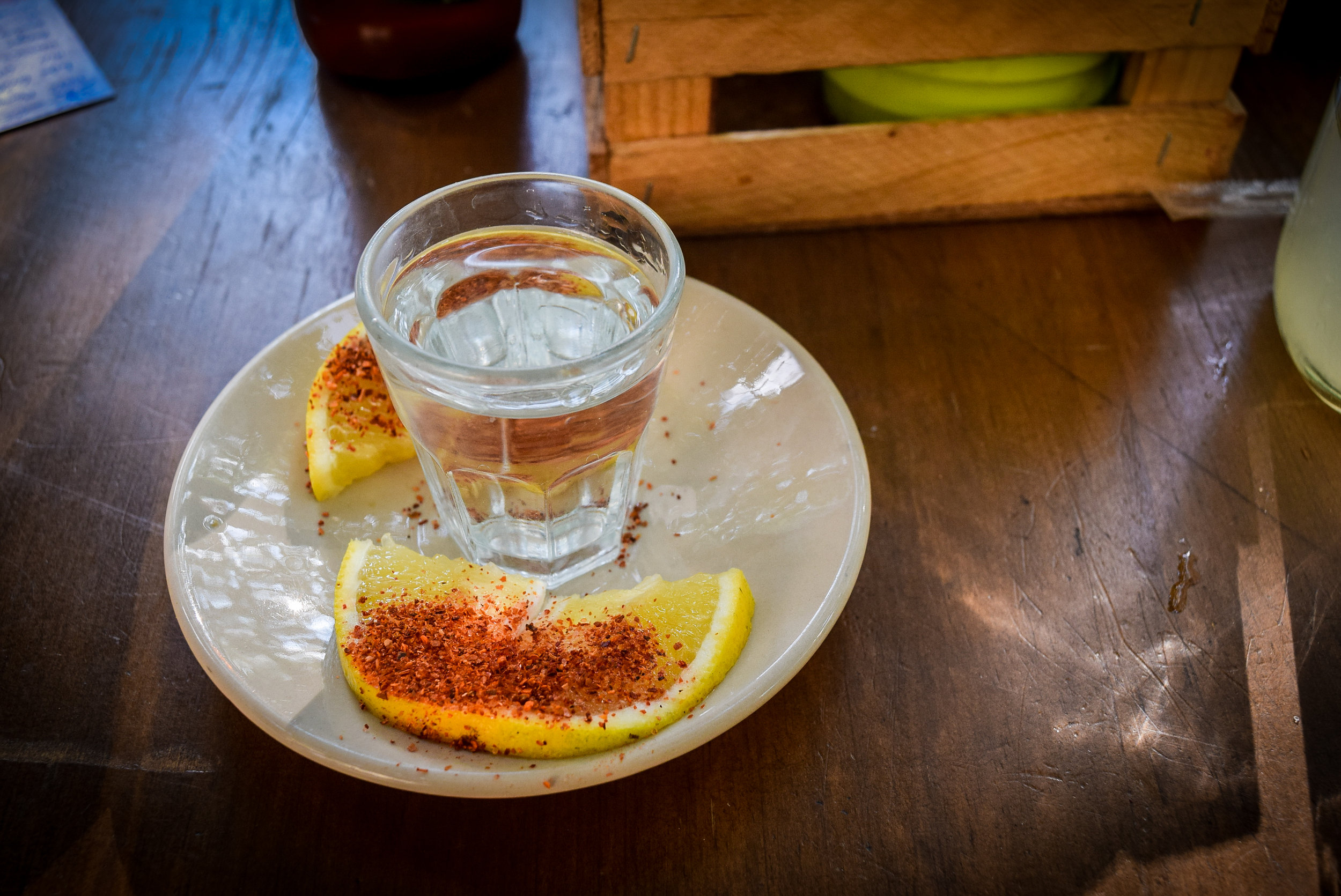 Mezcal with slices of fruit and worm salt