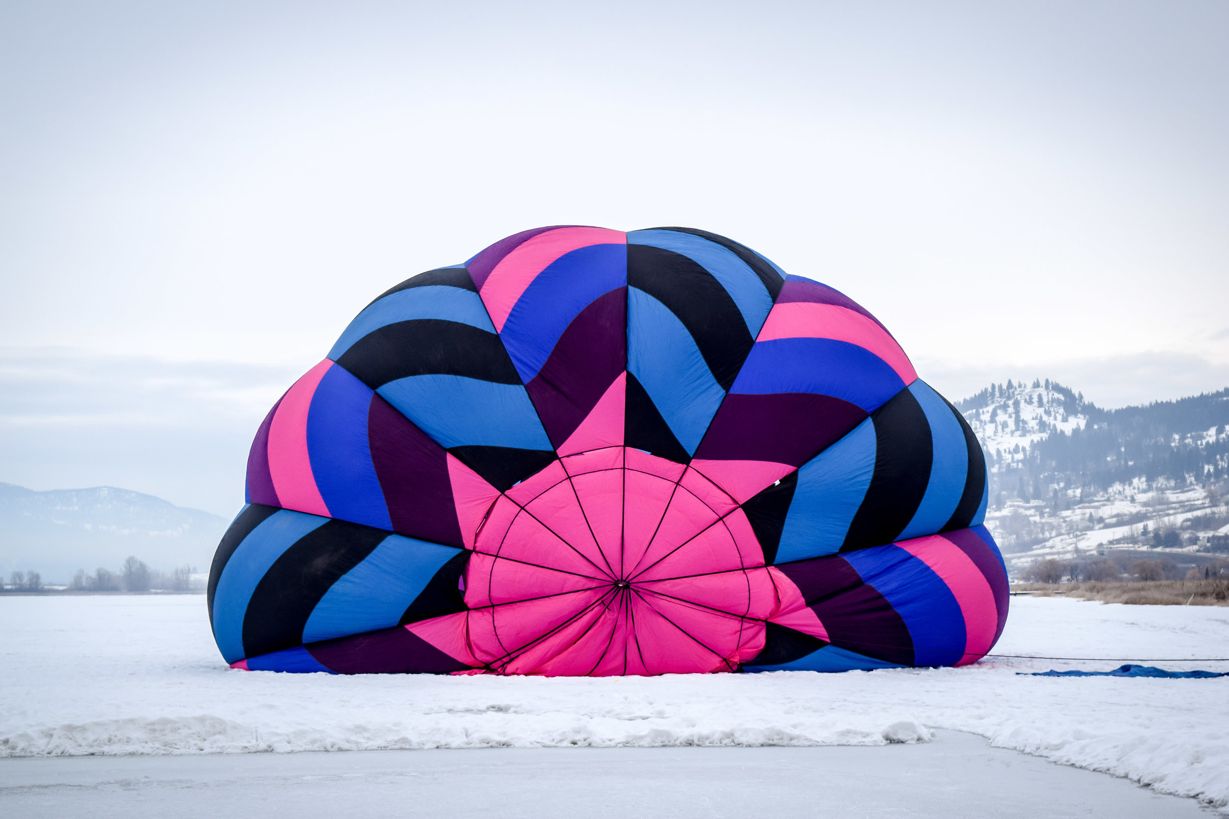 Blowing up a hot air balloon in winter