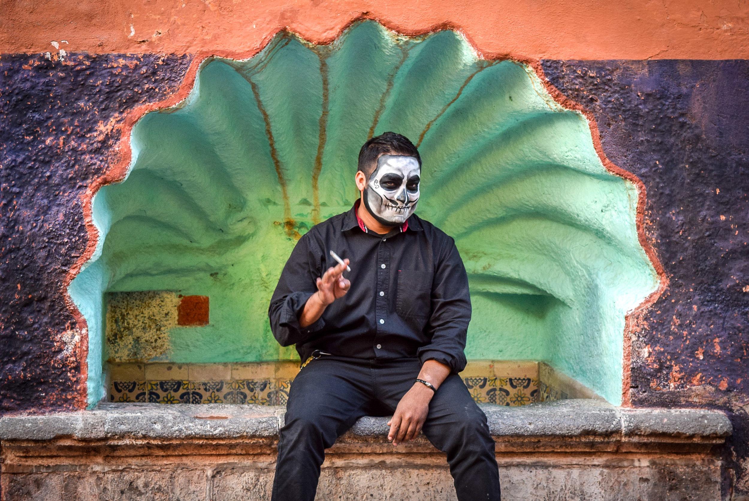 Face painted man in San Miguel de Allende during Dia de los Muertos celebrations