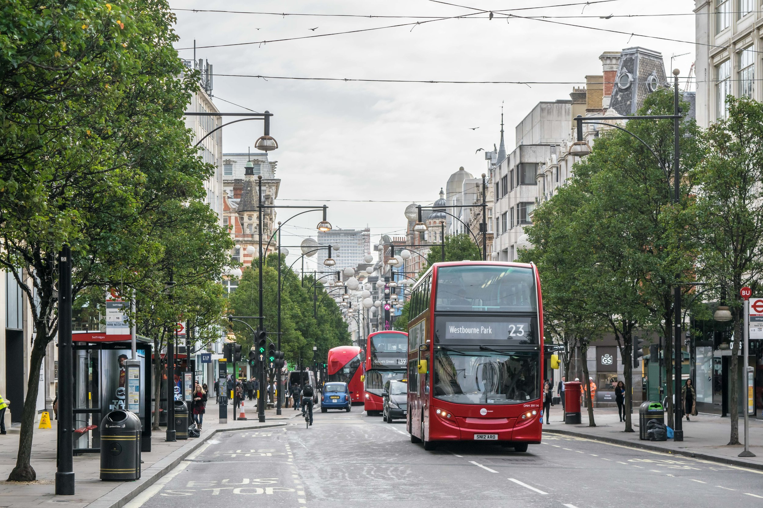 Red double decker buses on Oxford Street