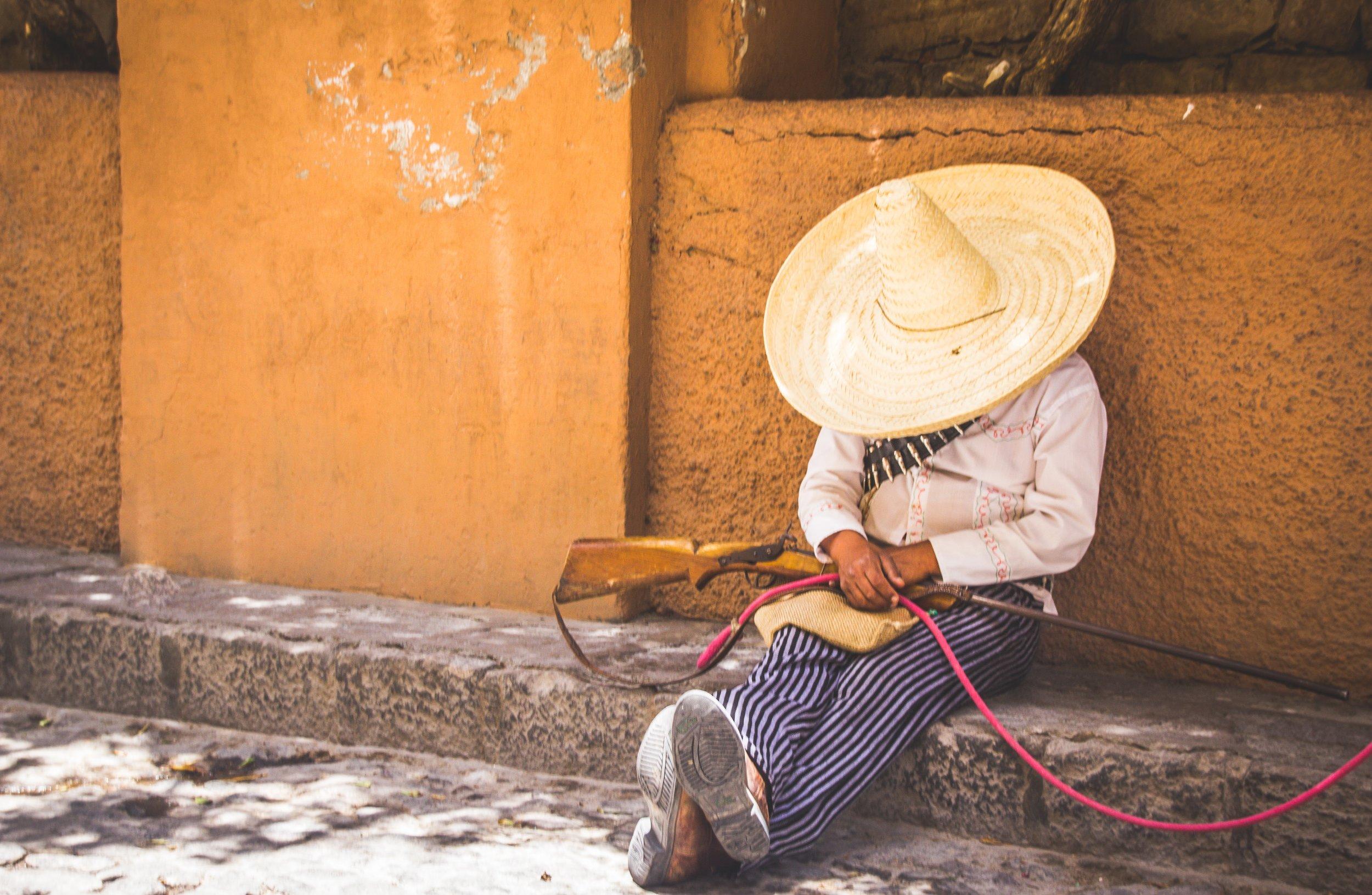 Man in sombrero resting