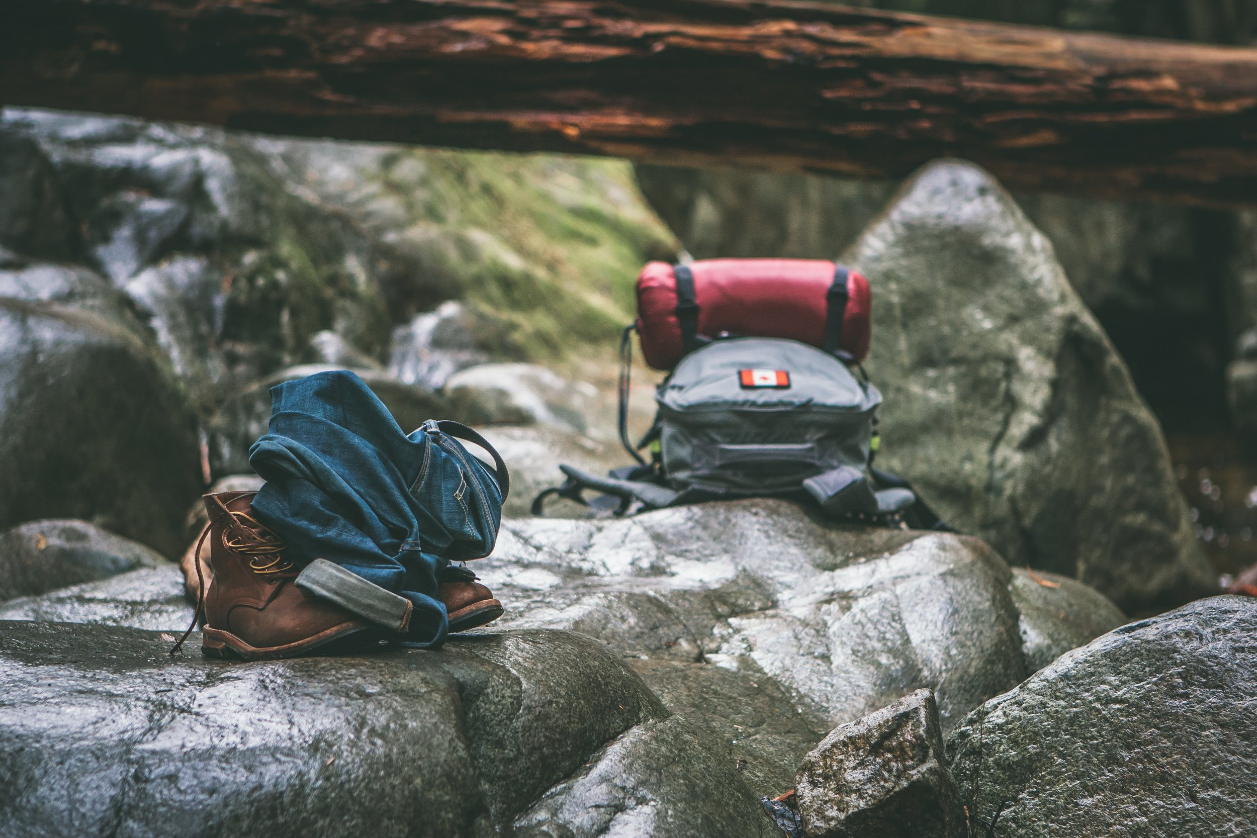 Hiking backpacks on boulders
