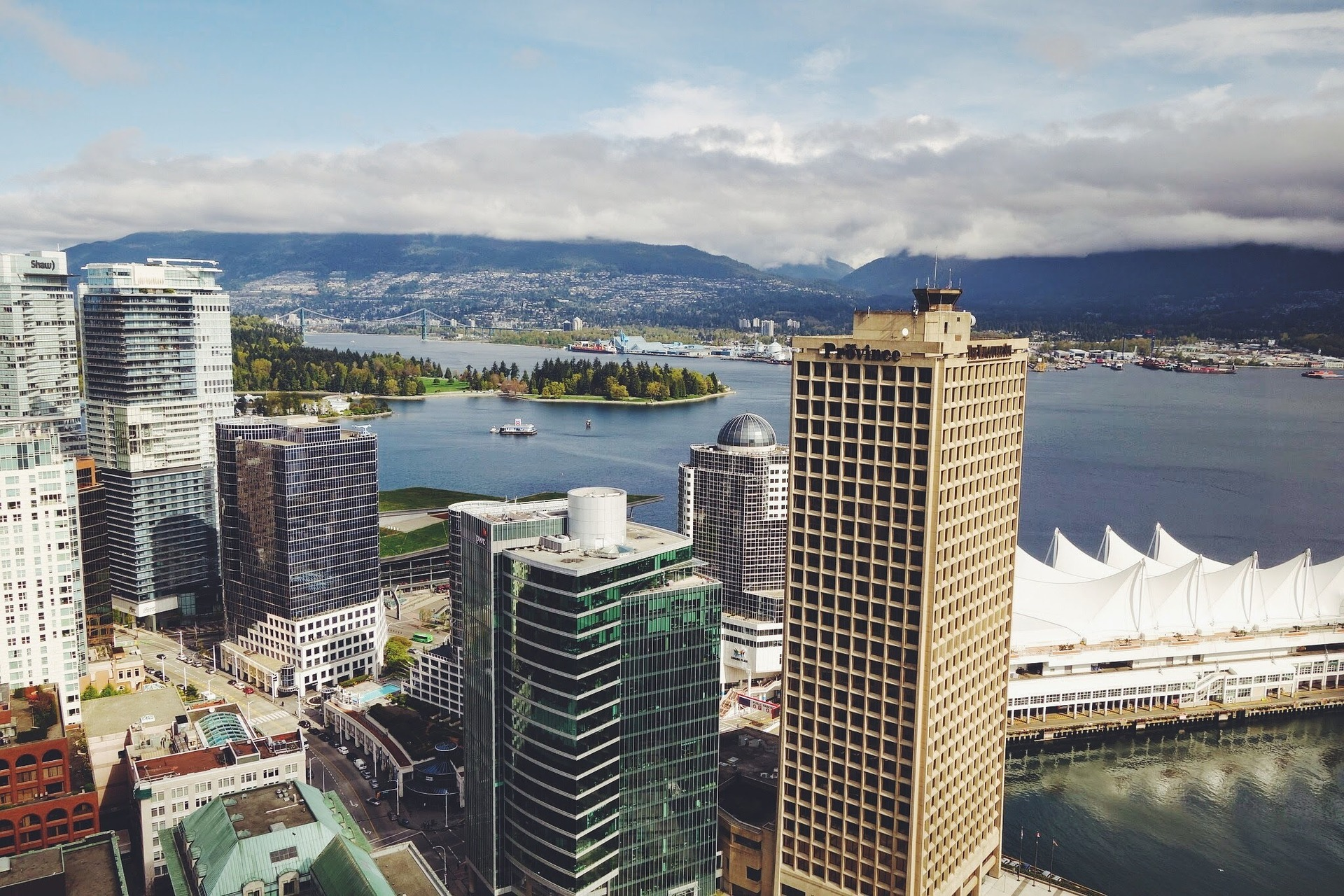 View of Coal Harbour, Canada Place, and the North Shore Mountains as seen from the Vancouver Lookout