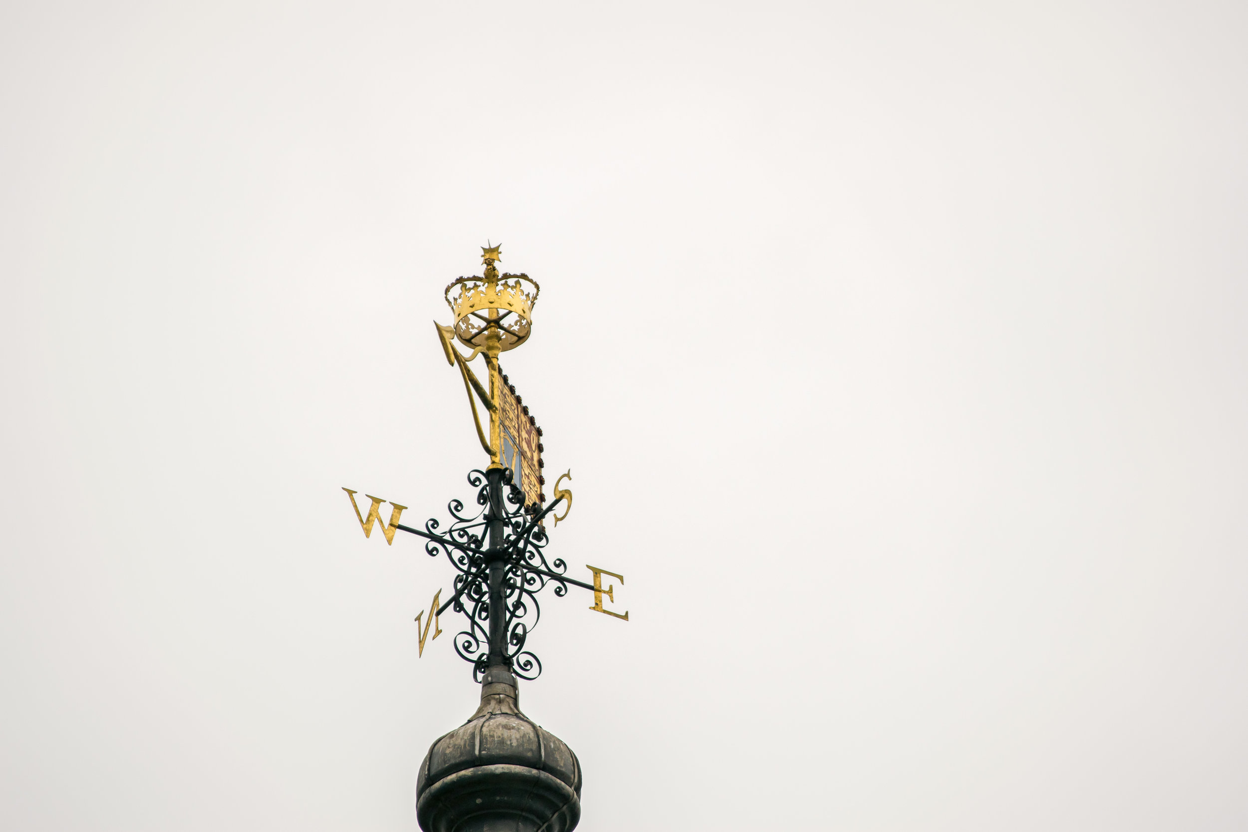 Directional signpost with crown atop the White Tower