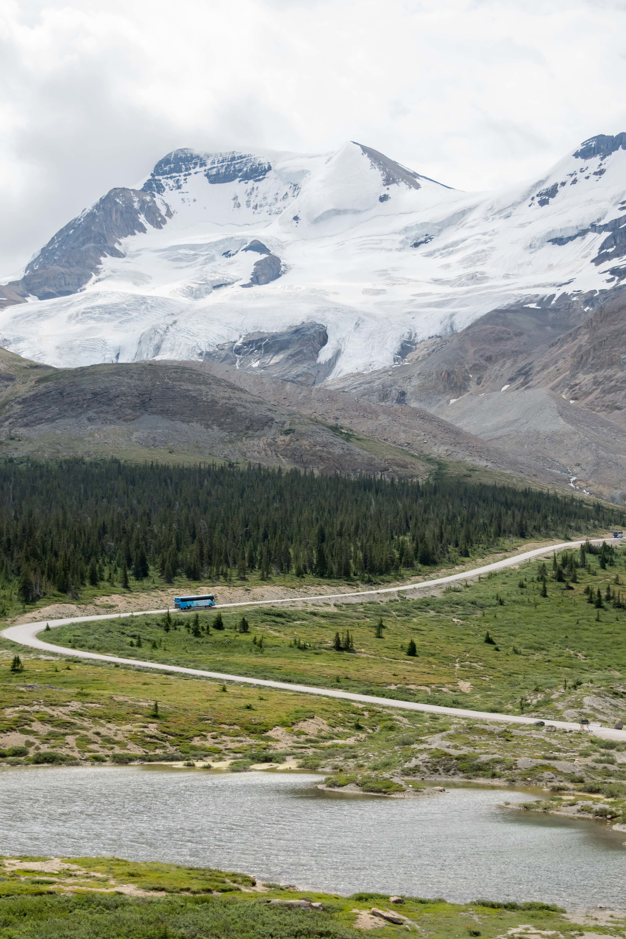 Bus driving past the Columbia Icefields