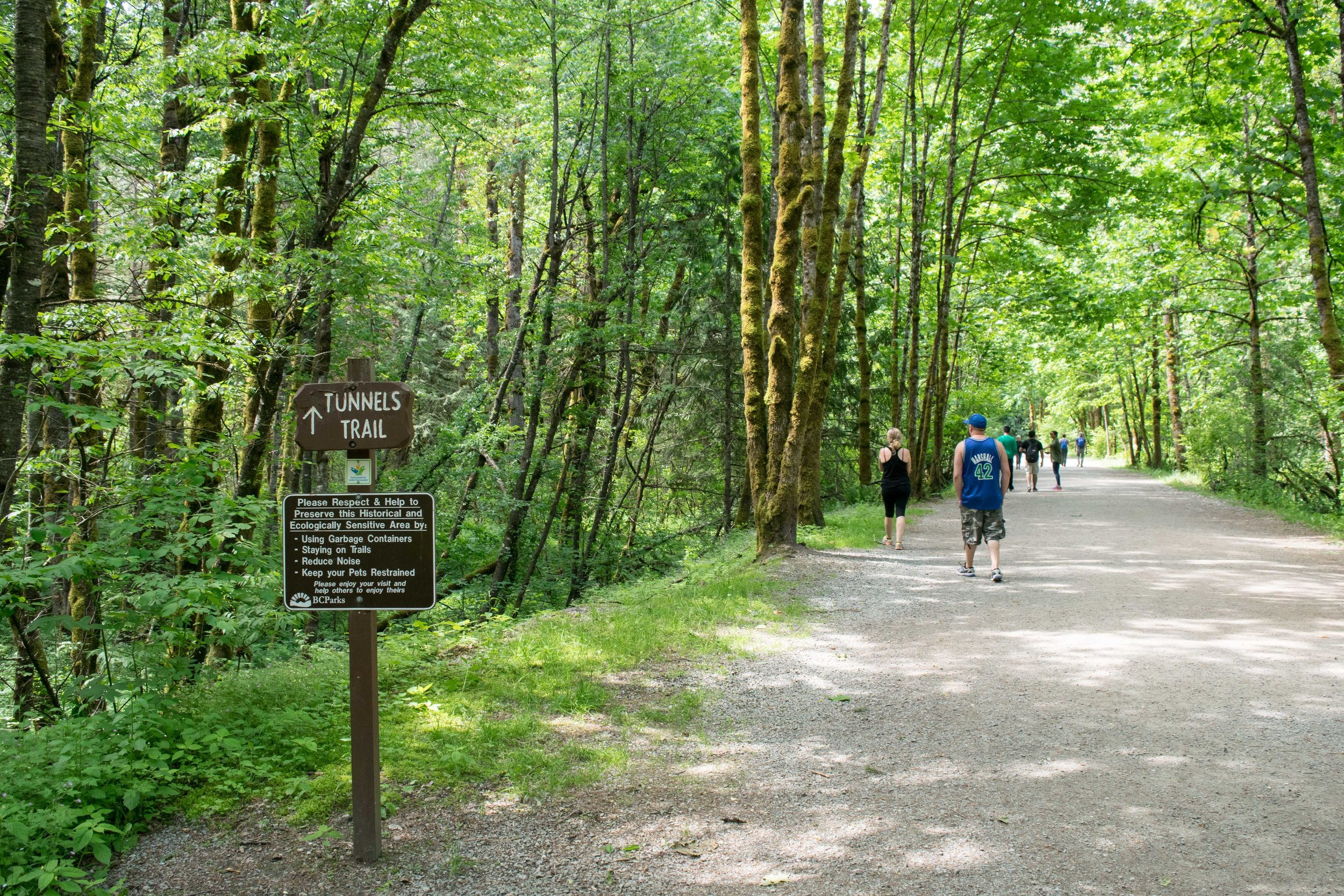 Visitors walking the Tunnel Trail in Coquihalla Canyon Provincial Park