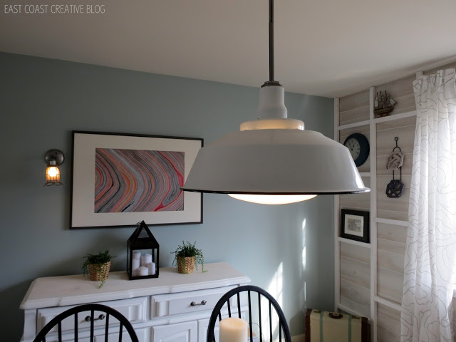 Lucent Lampworks customer photo featuring a white metal shade pendant.