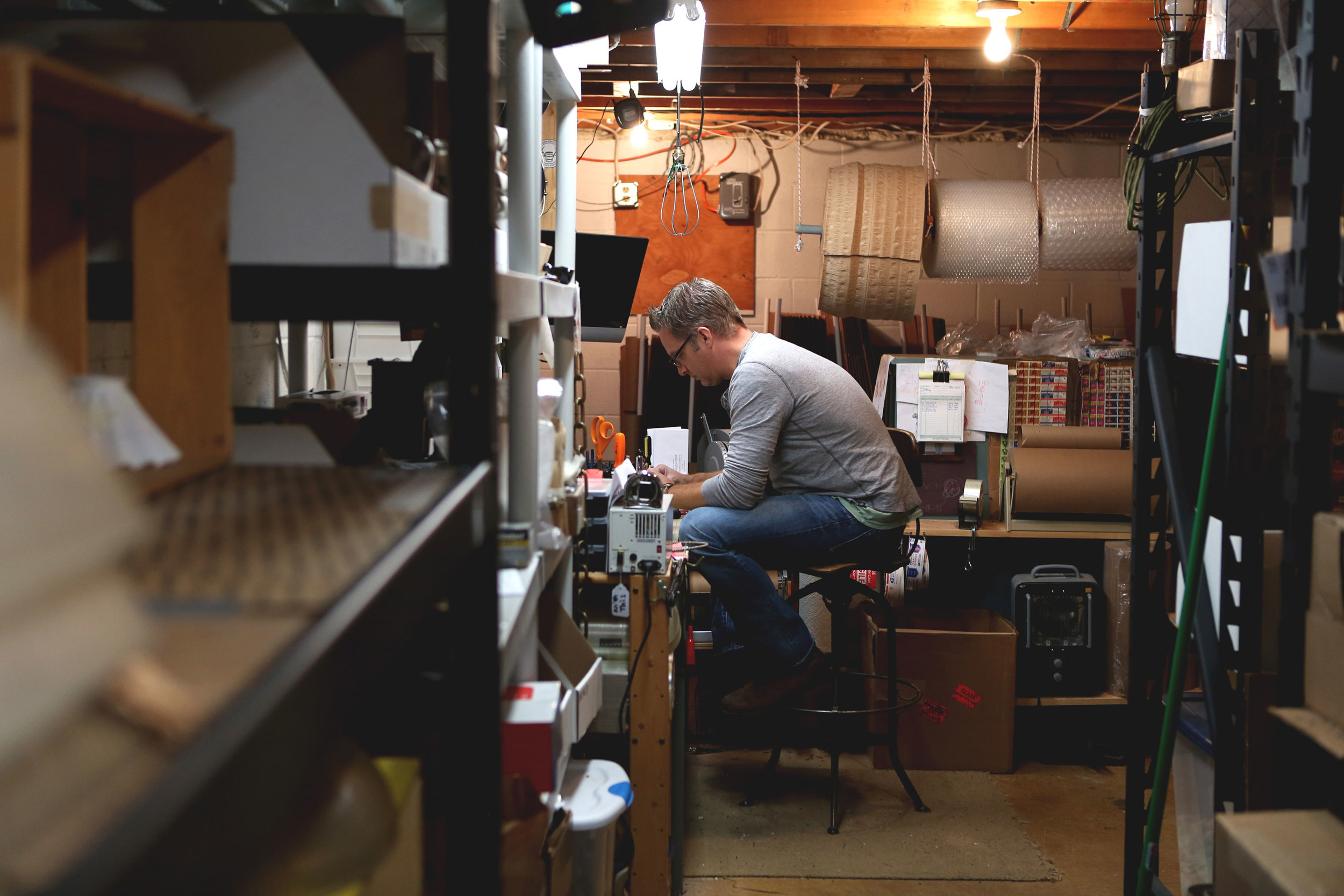 Brad Michael in the Lucent Lampworks shop in Bucks County, PA.