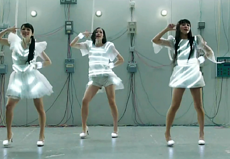 The three japanese singers of the J-Pop band Perfume wear light dresses in their Spring of Life music video, released April 11, 2012. Device design and development : Tomoaki Yanagisawa. Firmware programming : Motoi Ishibashi. Interaction design and software programming : Daito Manabe. Stylist : Shinichi Miter.